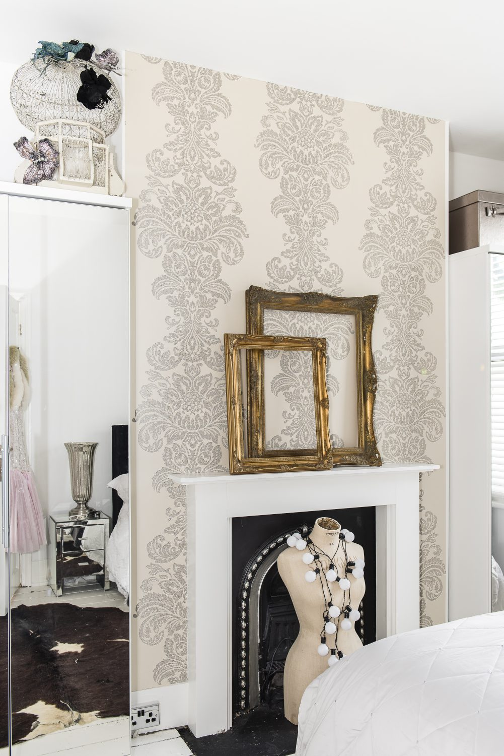 The wallpaper in the spare room, by Kandola, is hand-studded with Swarovski crystals