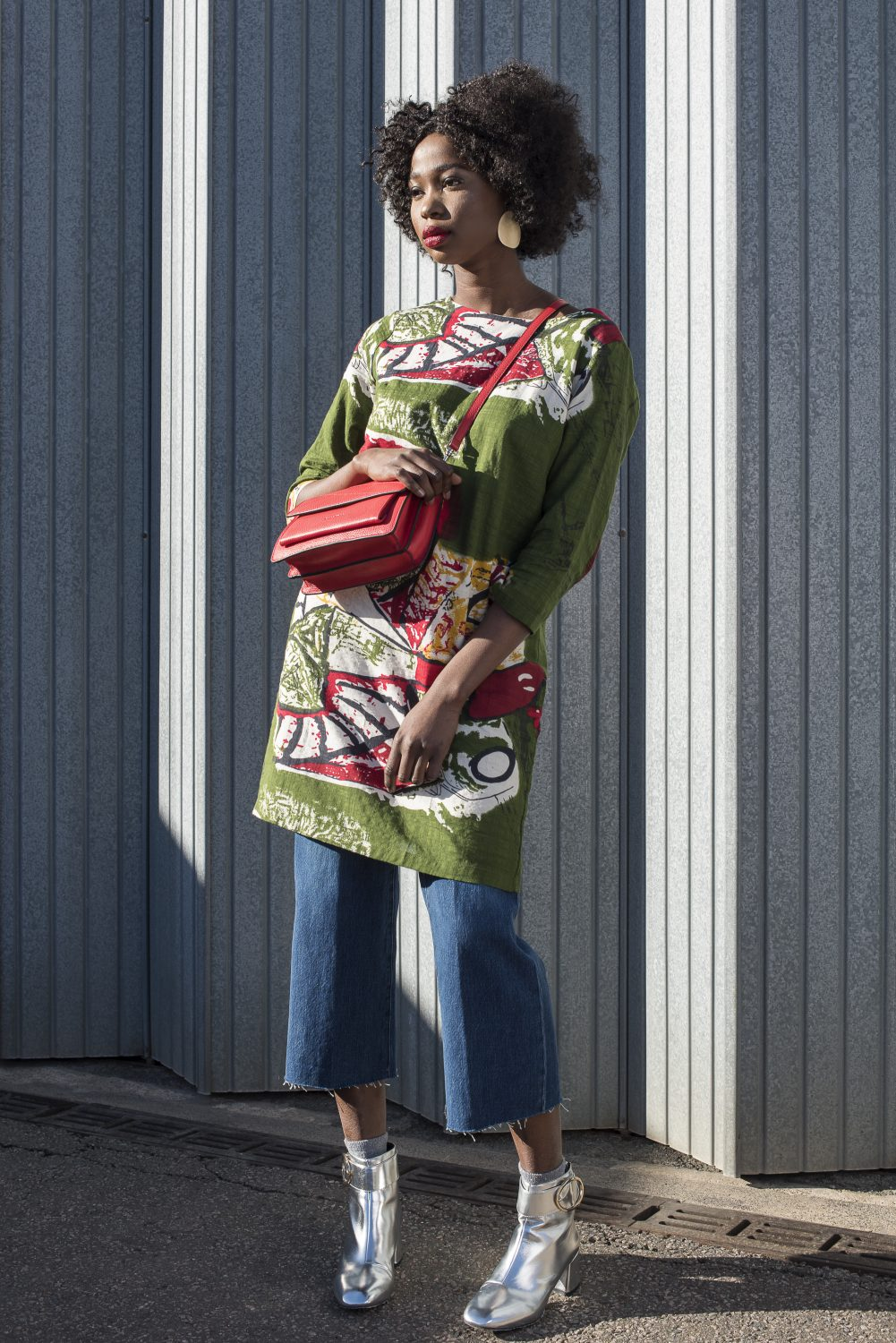 Printed tunic, £69, disc earrings, £19, Who's Wearing What Boutique whoswearingwhat- boutique.co.uk; cropped jeans. £245, Hall & Co halland.co; ankle boots, £79, Kurt Geiger at Ashford Designer Outlet ashforddesigneroutlet.com; bag, £99, manukashoes.com; ankle socks, stylist's own