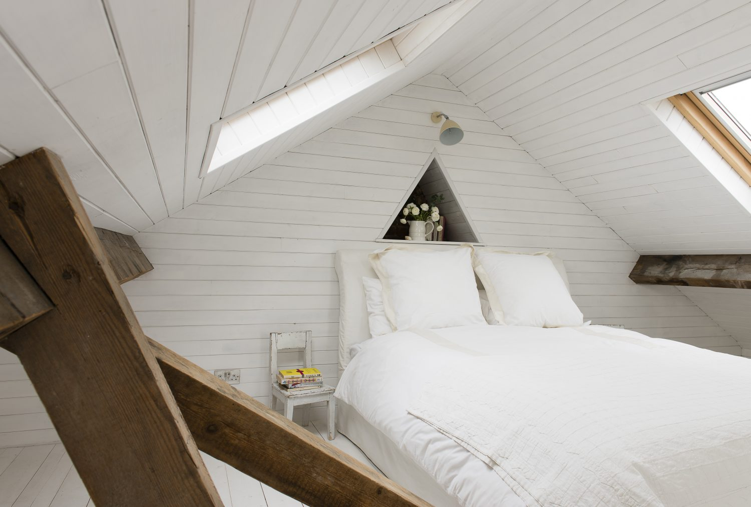 Marta created a new double bedroom in the eaves of the house, large and airy with light pouring through Velux windows, accessed by this ship-like ladder