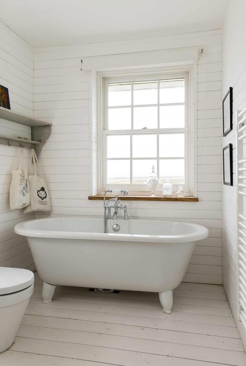 The house had been vandalised before Marta bought it, the bathroom smashed to pieces, so she had to put an entirely new one in. She panelled it with horizontal tongue and groove to make it feel warmer and put in a freestanding bath as that is what would have been there before