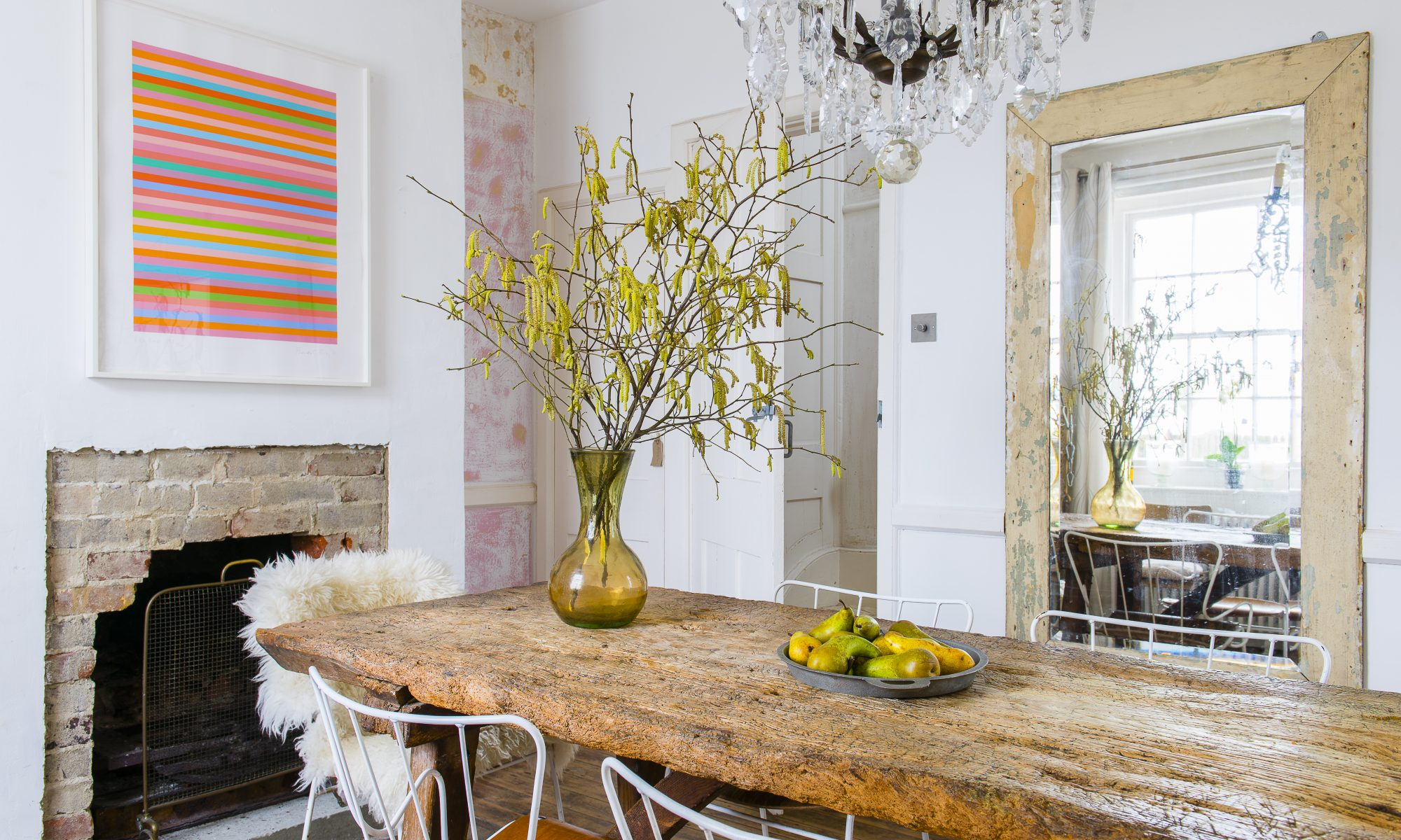 The dining table is medieval. It was given to Marta's father, an architect by a client in lieu of fees. Marta deliberately exposed the brickwork around the fireplace to reveal the building's fabric. The mirror is from McCully & Crane in Rye