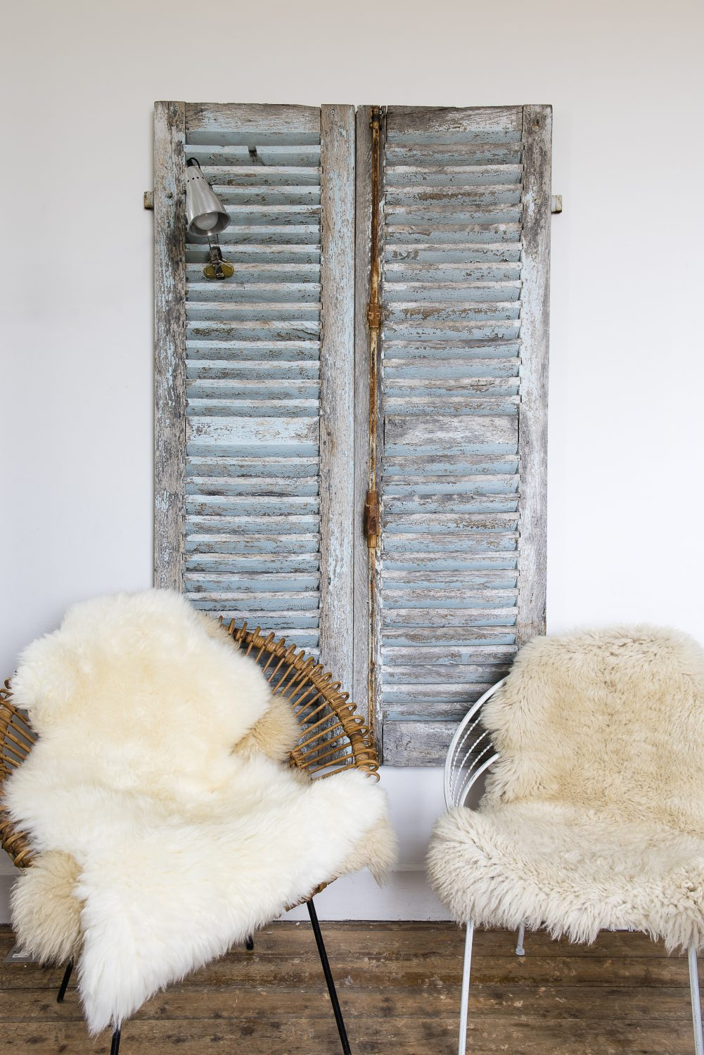 The salvaged shutters are French. Marta put them in to suggest a window where there isn't one. She also wanted to have French things in the house to reflect Rye's status as a Cinque Port
