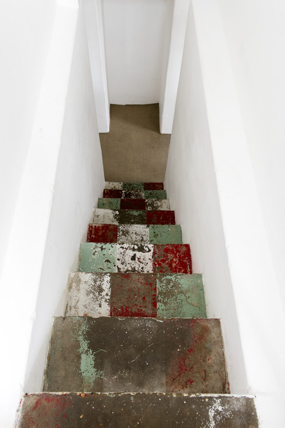 Marta left the patina of old paint on the main staircase, as part of the story of the house