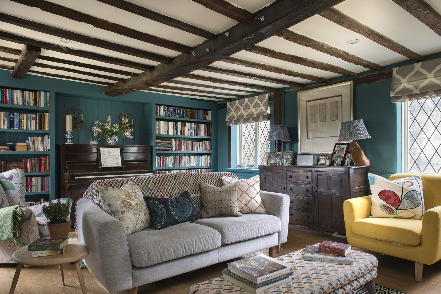 The oak sideboard used to be in the kitchen, but Ally thought it deserved a grander location. The chairs and sofa are from Furniture Village – to save money to spend on the bookshelves