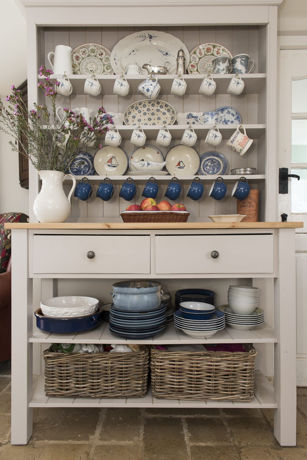 Ally had the dresser made to replace the dark wood dresser she moved to the sitting room and to reflect the kitchen's contemporary country style. Baskets and apple crates are her favourite tools for keeping clutter organised