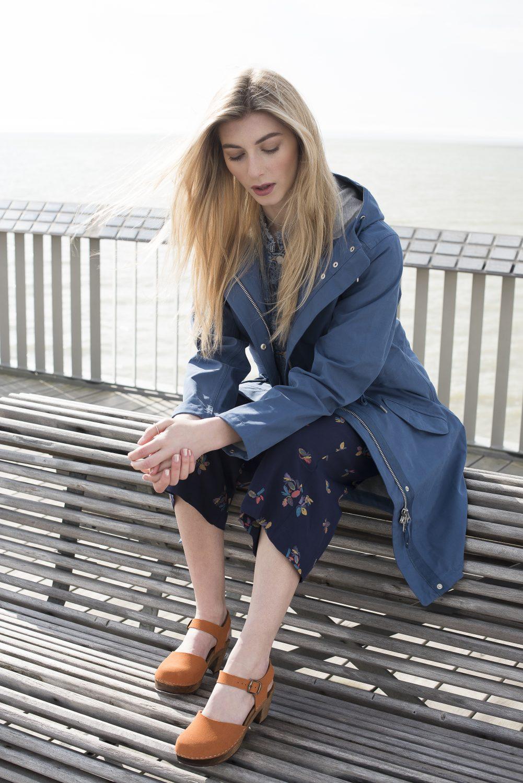 Ilse Jacobsen raincoat, £230, Travelling Bazaar travelling-bazaar.com; denim jacket, £38.49, Gap at Ashford Designer Outlet ashforddesigneroutlet.com; printed jumpsuit, £165, Bod & Ted, bodandted.co.uk; rust leather clogs, £119, Kitty Clogs Sweden kittyclogssweden.co.uk