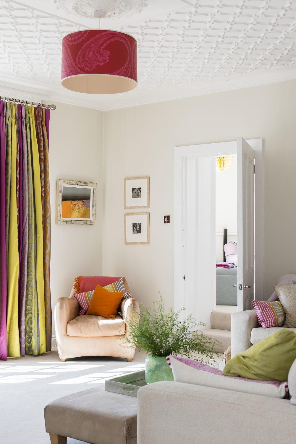 The curtain fabric is by Designers Guild. Sara changes the cushion covers, which are supplied by Spyros Hambis - Studio Interiors, seasonally. The painting was bought while travelling