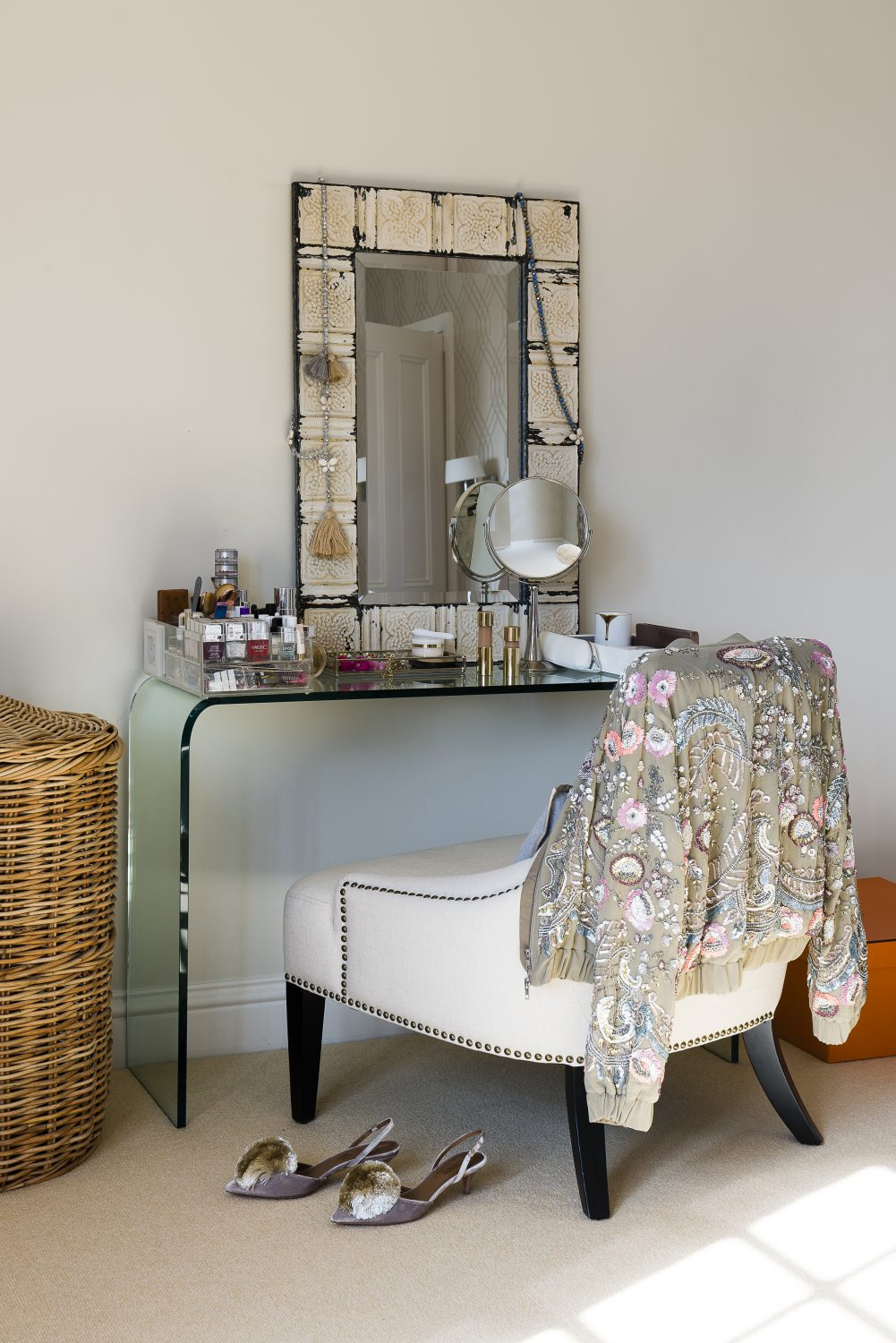 Sara's dressing table is from 1stdibs.com and the mirror behind is from US interiors store Lillian August.The jacket on the chair is a favourite jacket by Needle & Thread
