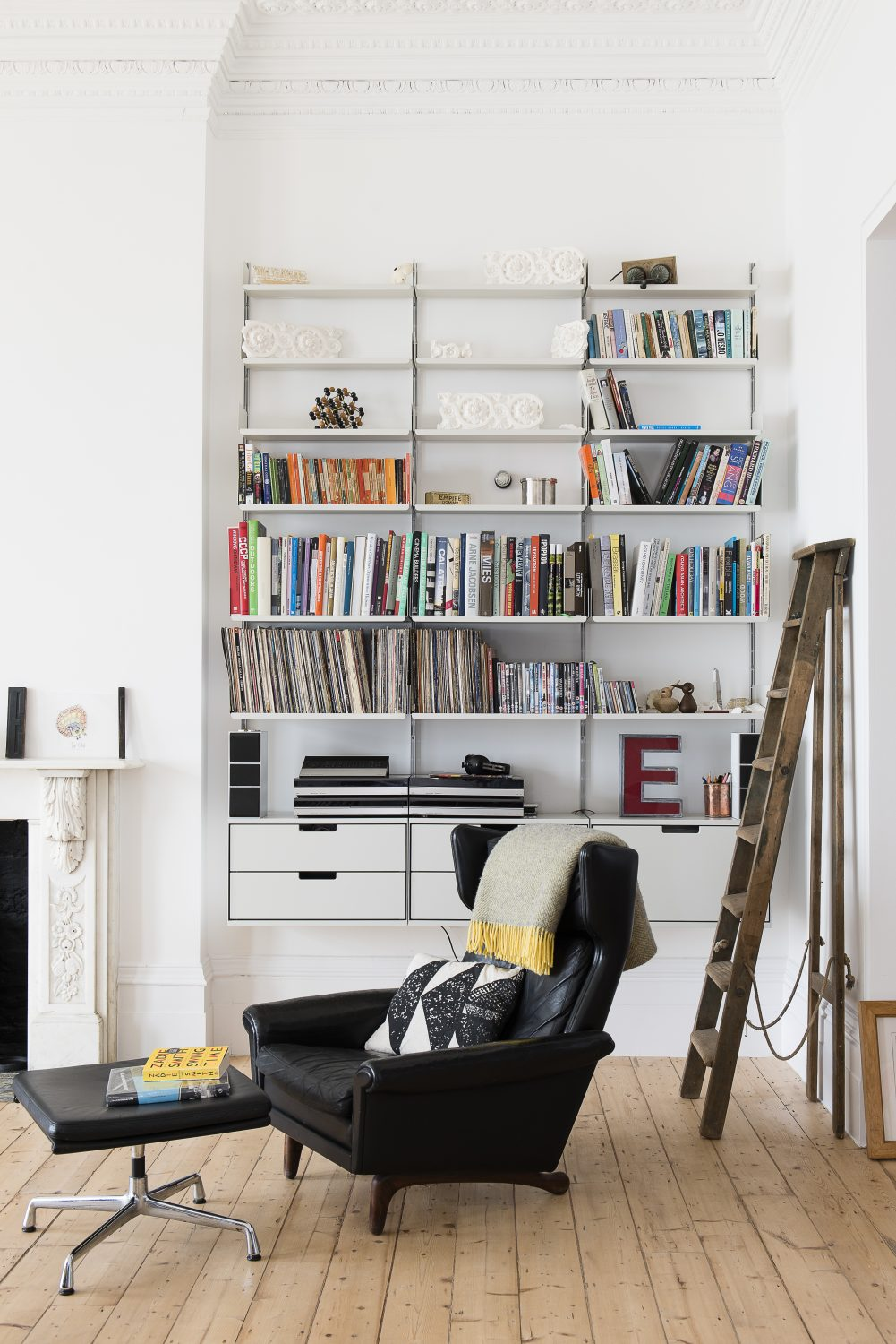 Dieter Rams' shelving by Vitsoe Above left: The garden seen through the kitchen window at the back of the house. The vintage haberdasher's cabinet is from ebay