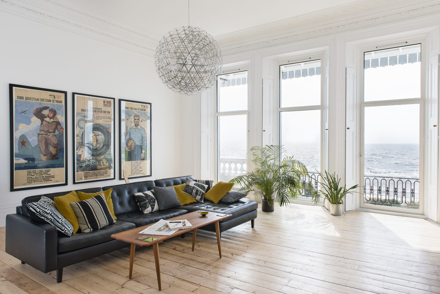 The main living space is in what was originally the ballroom of the house. The paintings are by house owner Ed Williams, inspired by the Soviet-era artworks in the nearby Baker Mamonova Gallery
