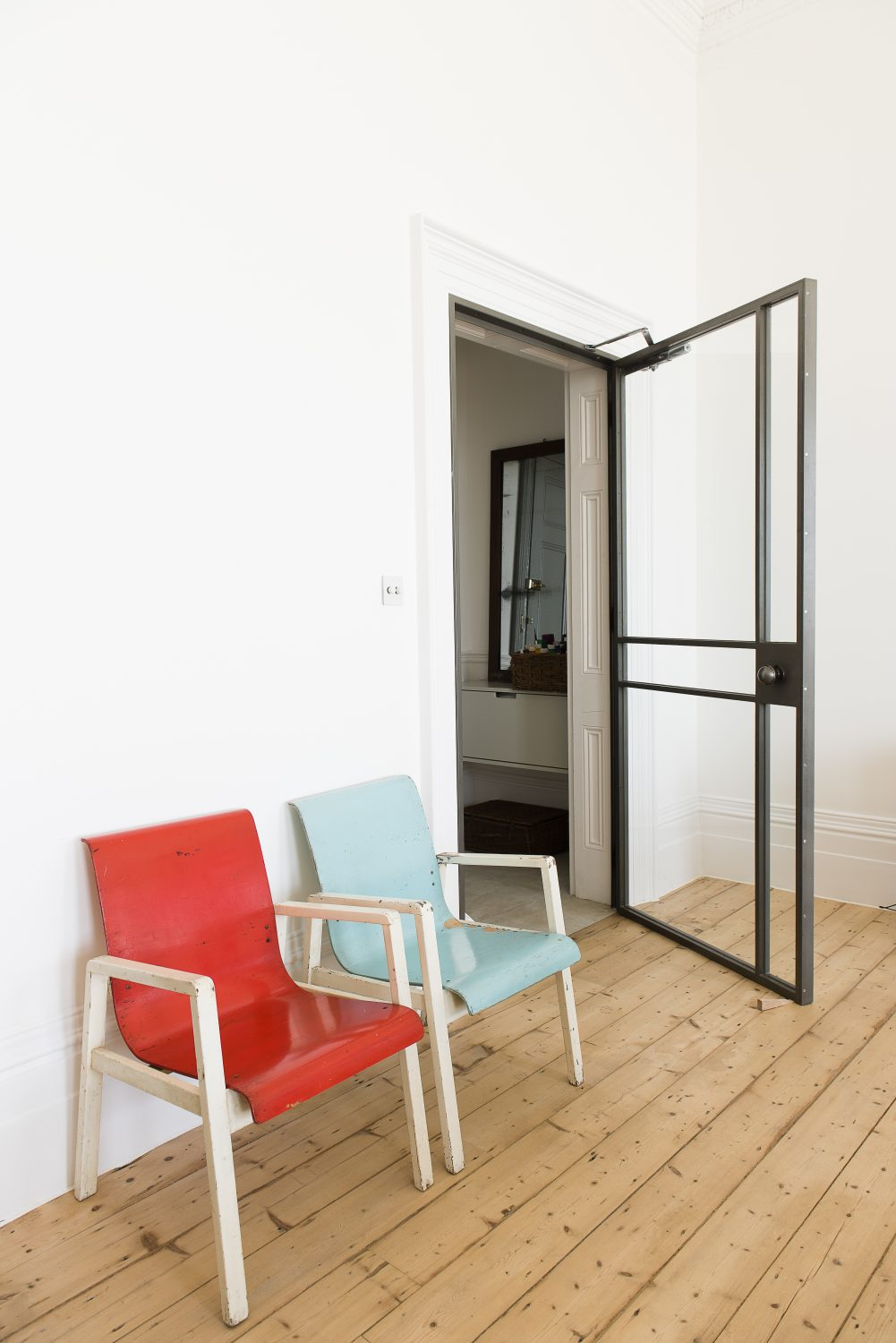 The steel-framed doors were made by a local craftsman. The chairs are originals by Alvar Aalto from De La Warr Pavilion in Bexhill