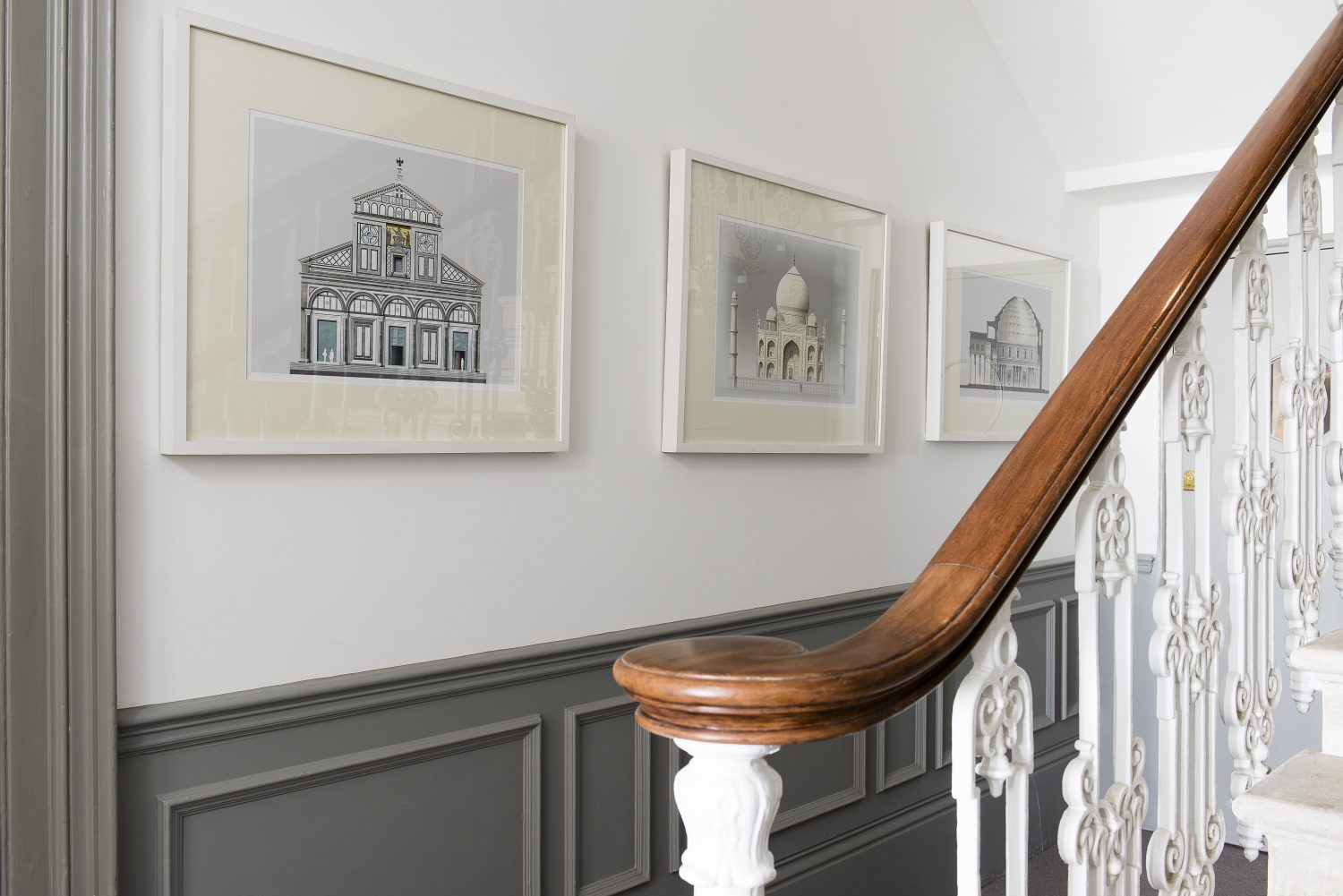 The couple restored the original stone staircase and wrought iron bannisters. Original drawings by Gerry Whale