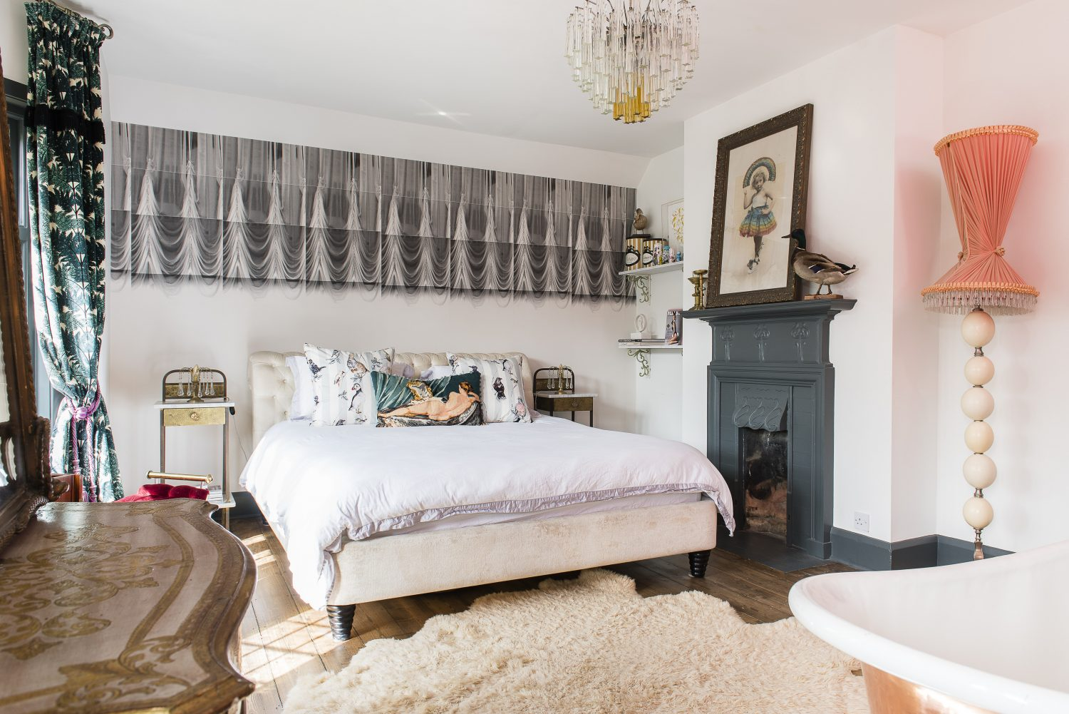 Above: The master suite. The bed is from Selfridges. A corset-shaped lightshade by Sera of London sits atop a 70s base made with real ostrich eggs Below left: Saucy touches include a framed copy of Playboy with Kate Moss on the cover