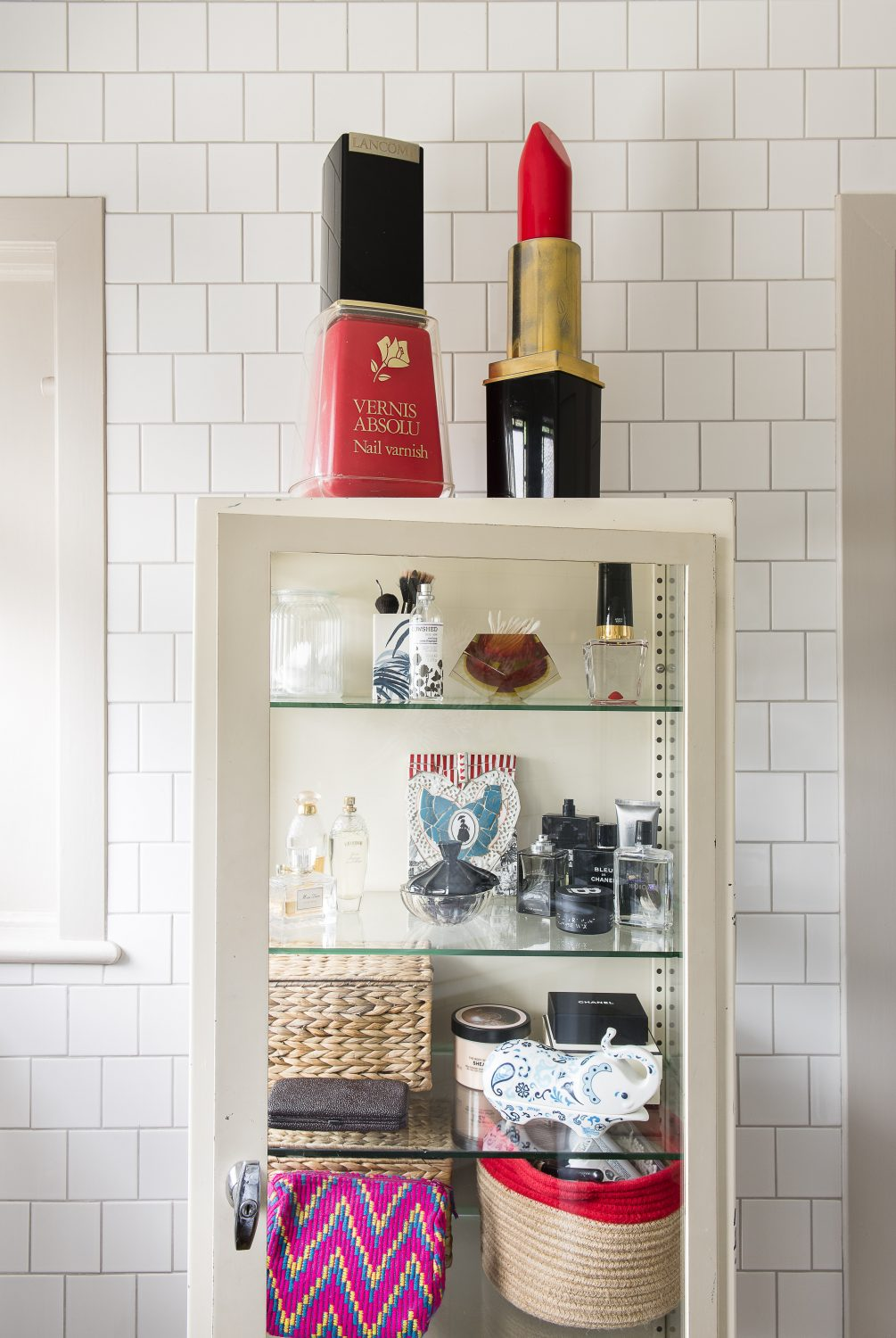 A French metal medicine cabinet. The giant nail varnish and lipstick were from an 80s shop display