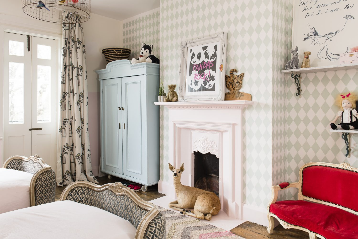 Daughter Tippi Rose's bedroom is full of animals from the feathered fake swan head to the deer which sits in front of the fireplace. Bed linen is from M&S