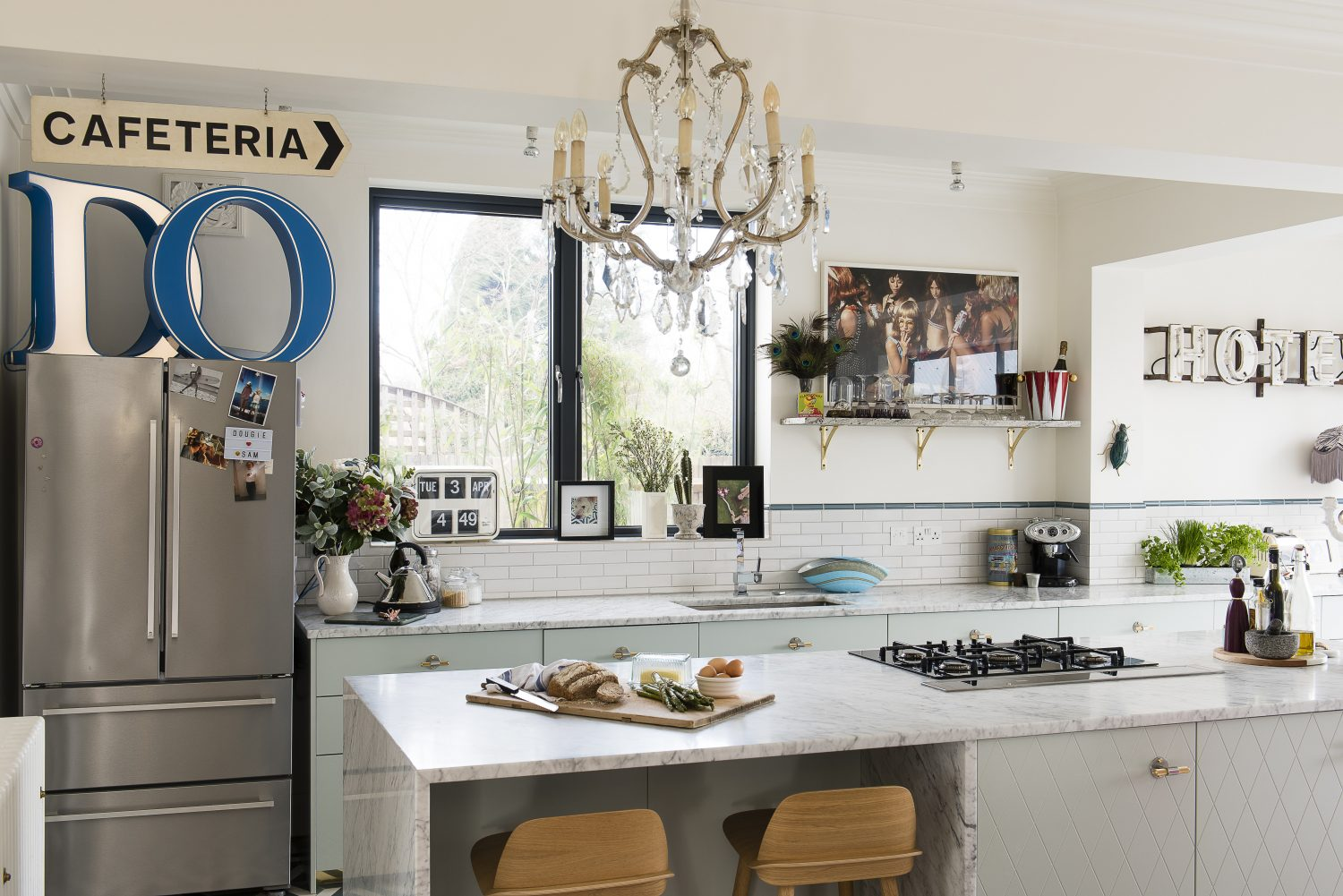 A huge marble island separates the cooking and dining areas