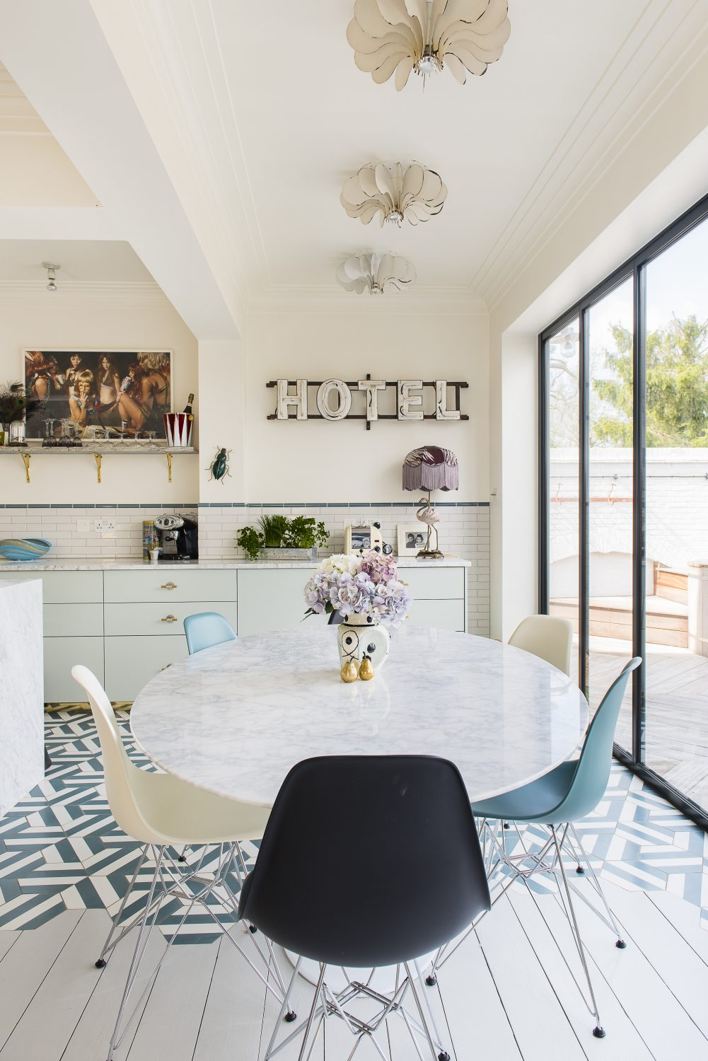 Samantha and Dougie's first task was to renovate the kitchen to create an airy open plan family space that maximised the outdoor view