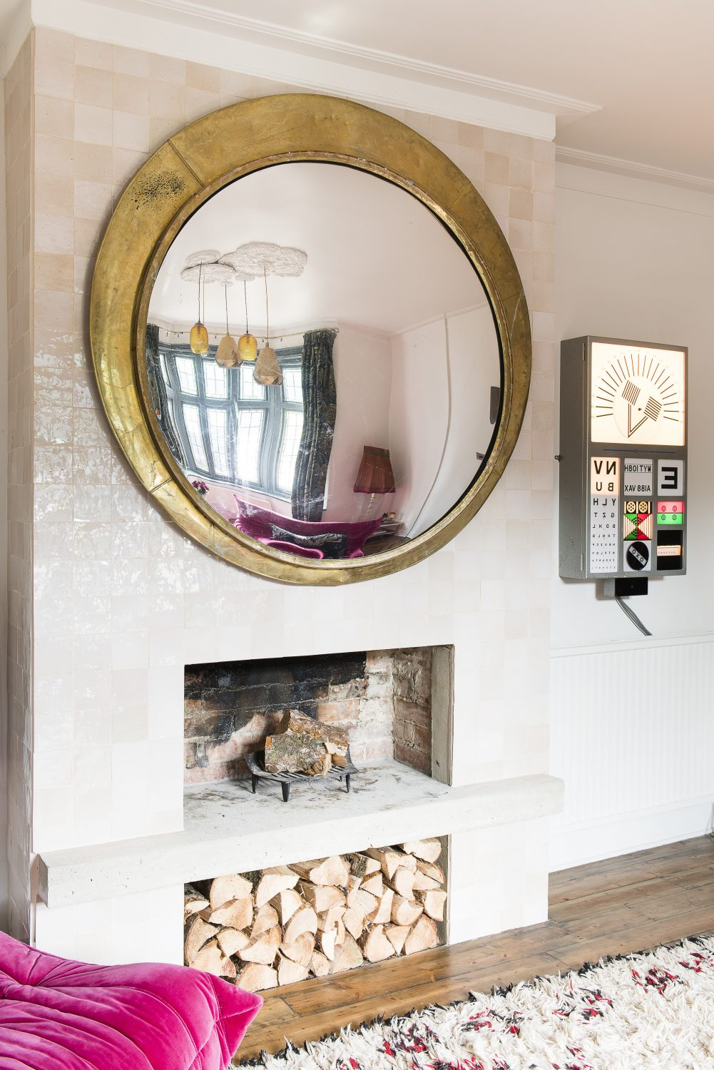 A reproduction of a Czech railway convex mirror, prints by Ben Eine and a fully working old electronic eye test found at a French market decorate the sitting room This page: The photograph is by fashion photographer, Alex Prager. The kitchen cupboard door handles are from Buster + Punch