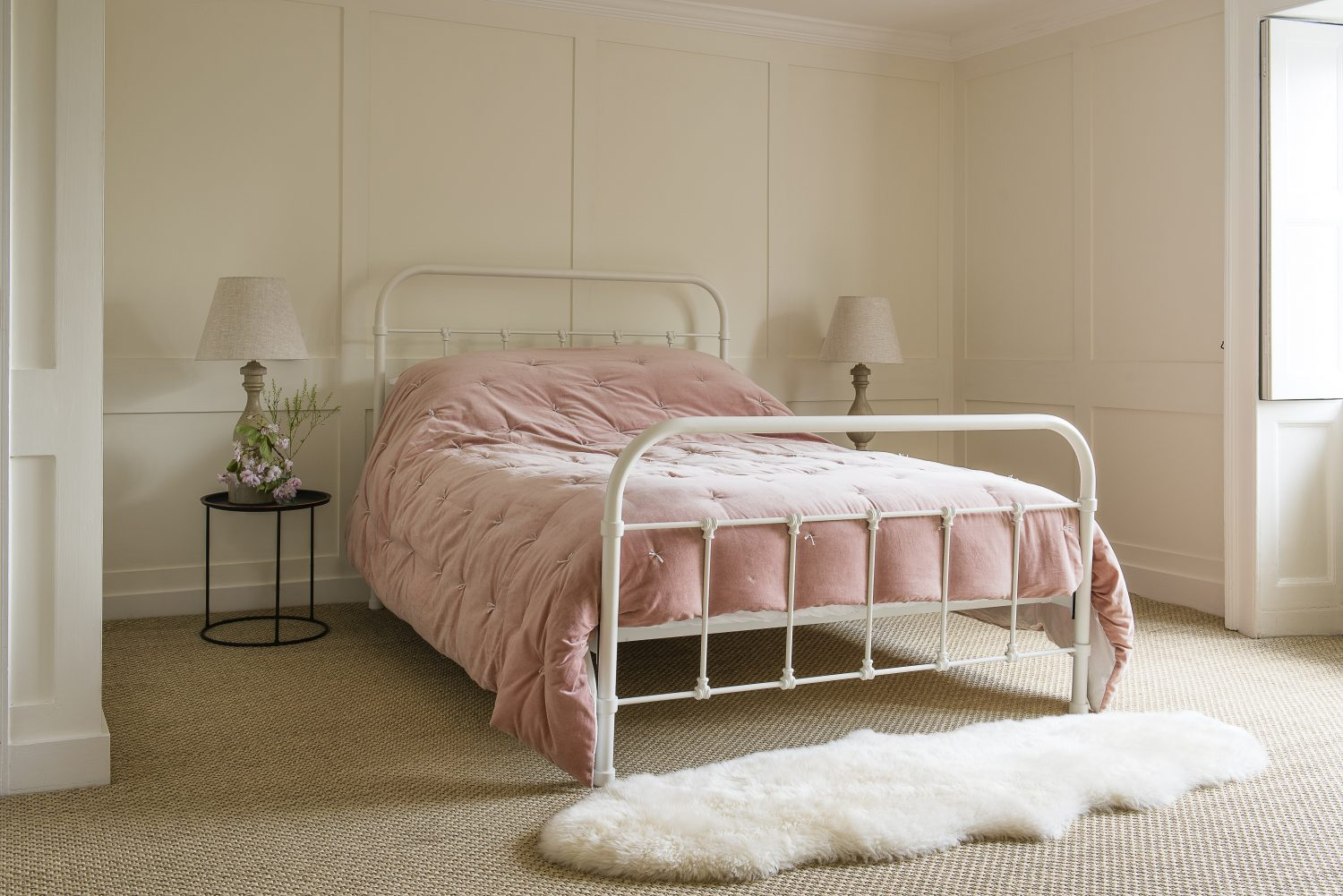A pale pink Graham & Green bedspread in the main bedroom is offset by yellows and reds