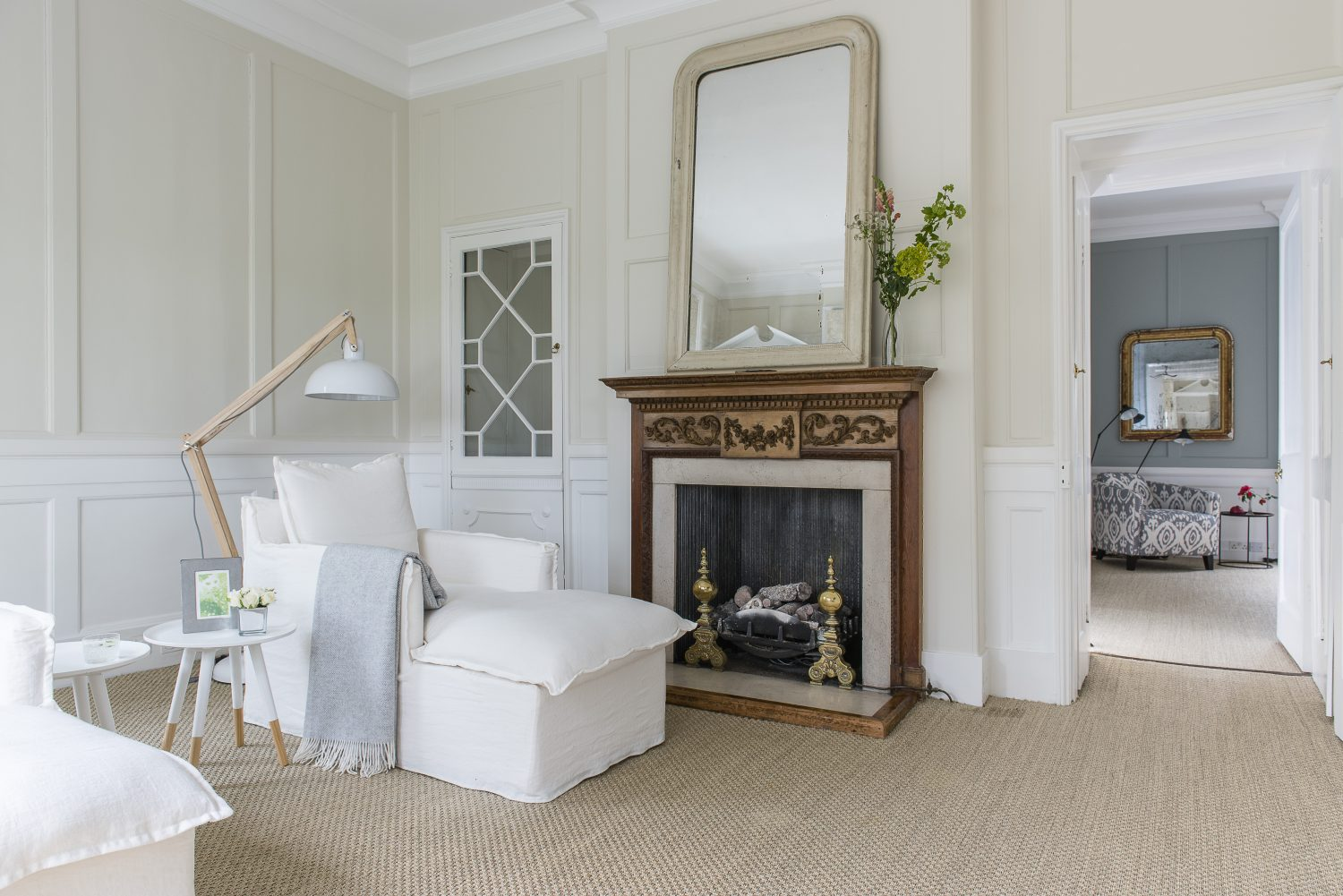 The first floor is largely taken up by the master suite. Each room has its own big and beautiful fireplace, often decorated with vintage mirrors, suitably cracked and worn in patches. The Isaac daybed is from sofa.com