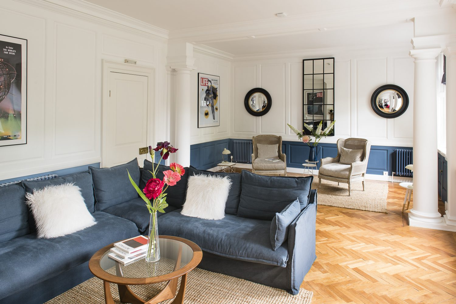 In the drawing room, barred mirrors reflect the Georgian bars of the actual windows. The sofa.com sofa matches the lower wall to create a simple but controlled effect