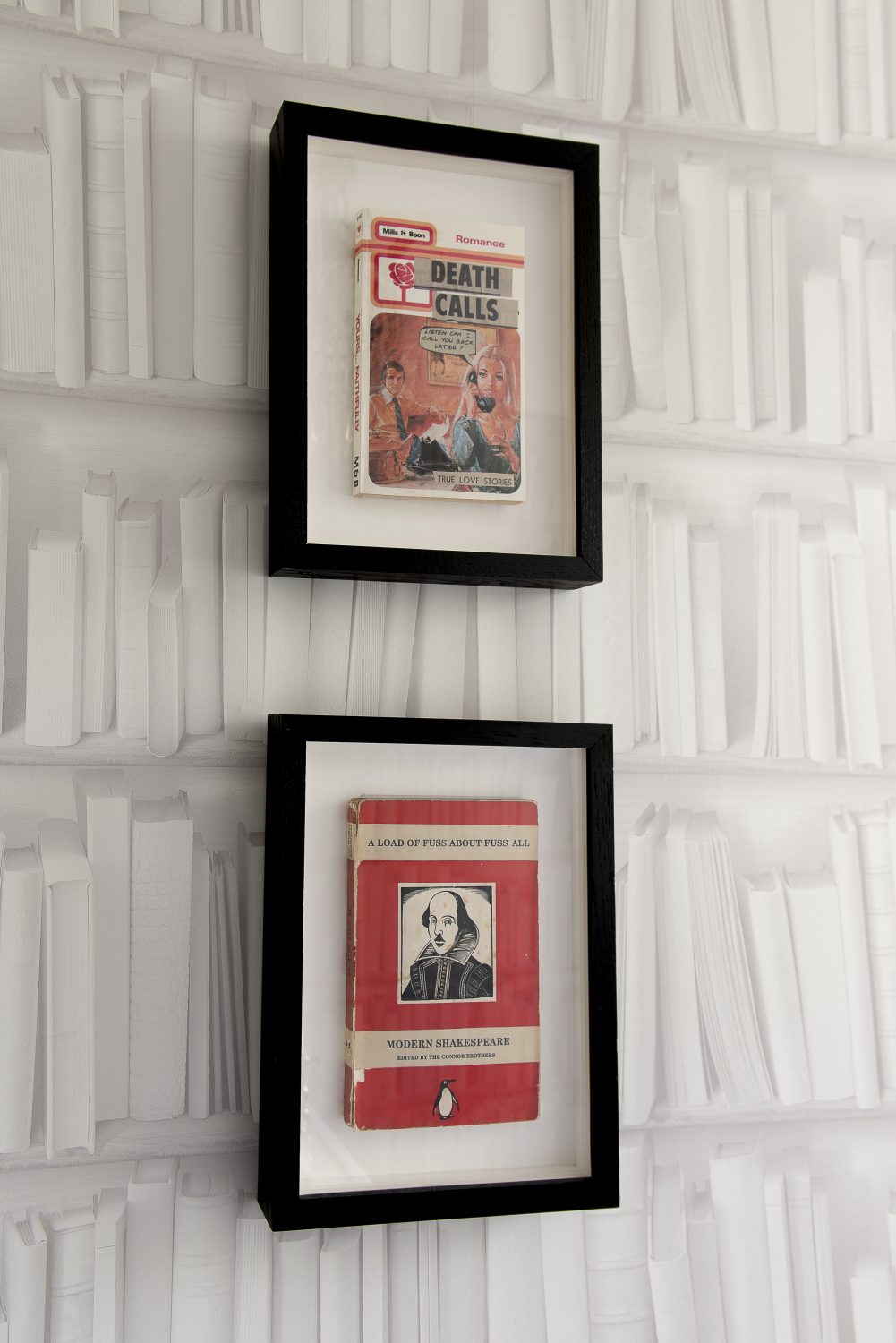 The 'Library Loo' featuring a table made of books, book cover art by the Connor Brothers, from Lilford Galleries in Canterbury, hanging books, book wallpaper – and a book that is really a shelf