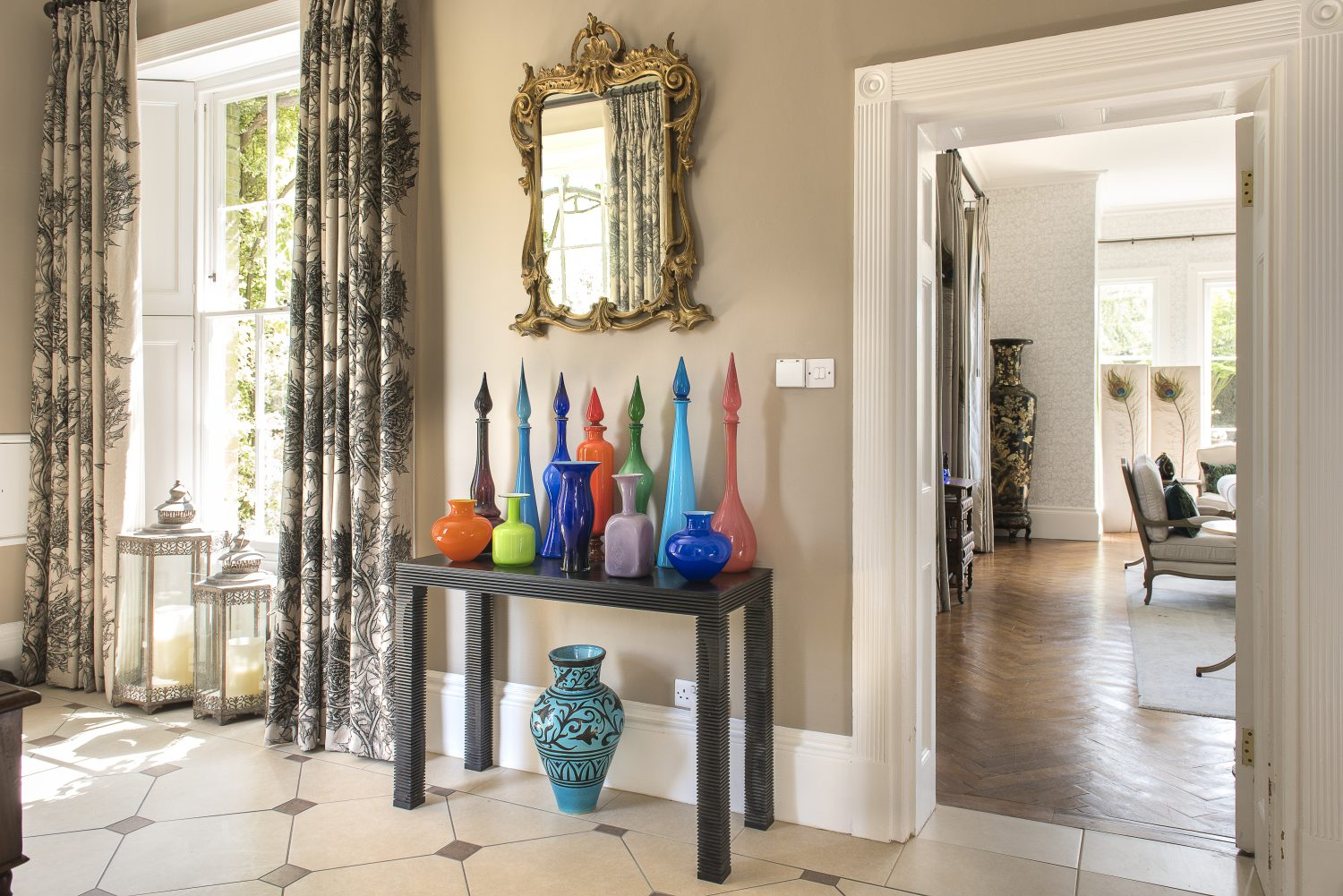 The first glimpse of Jane's extensive collection of Murano glass in the main hall. The ebony console table is by Gareth Neal