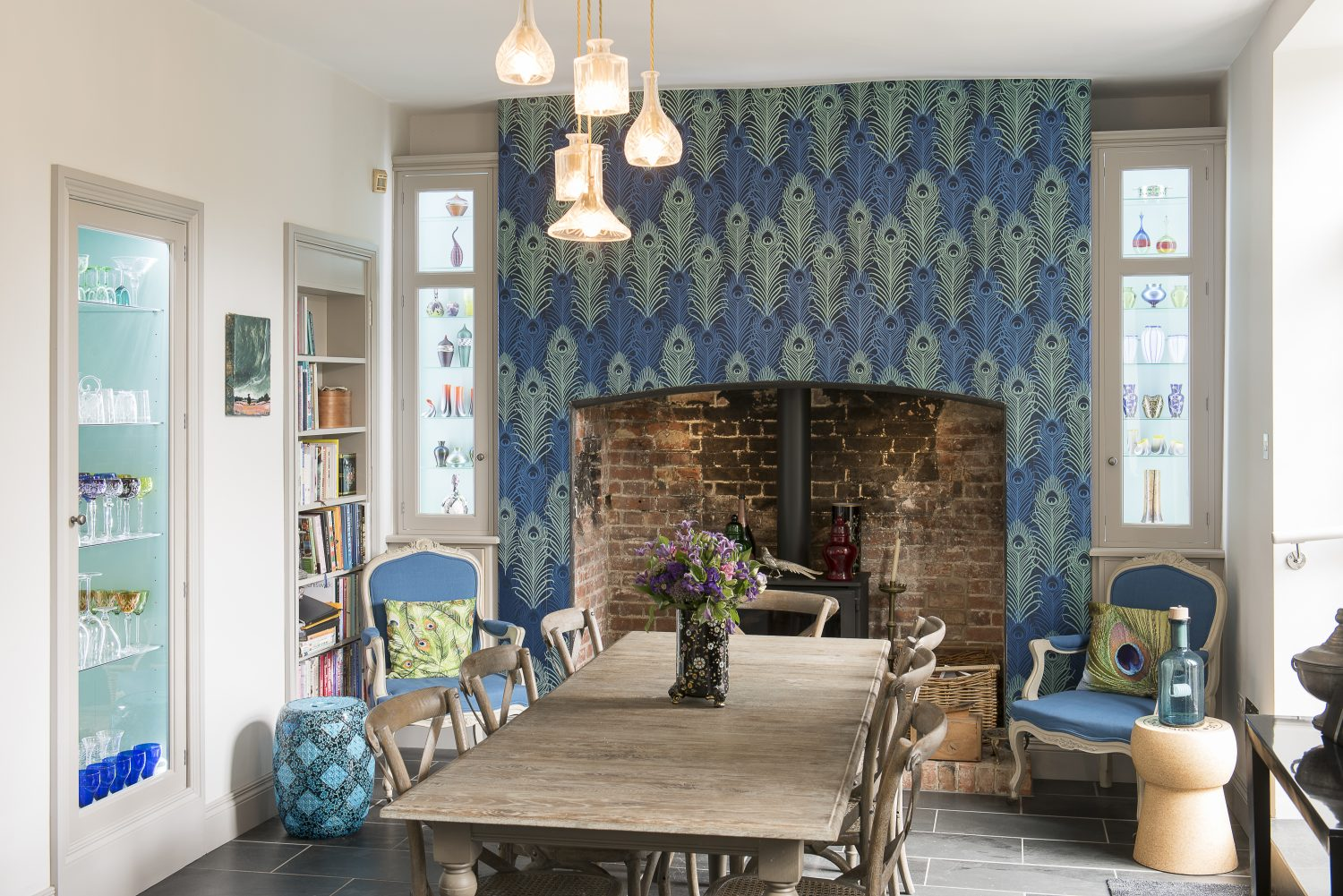 Jane's love of peacock feathers is in strong evidence in the kitchen. The wallpaper is by Matthew Williamson. The chandelier is by Lee Broom