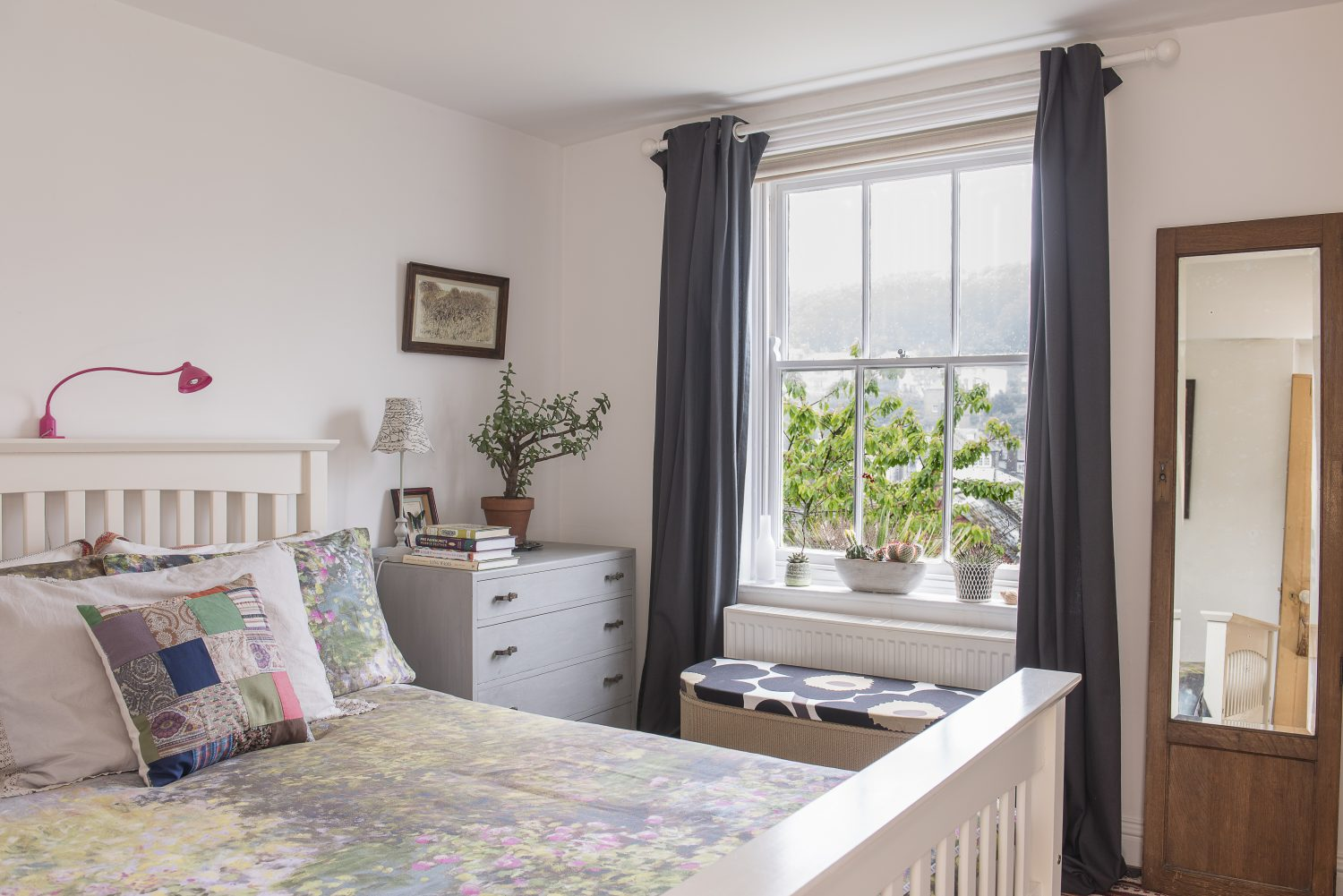 The spare bedroom has views over the Old Town. The grey curtains are from Marks & Spencer