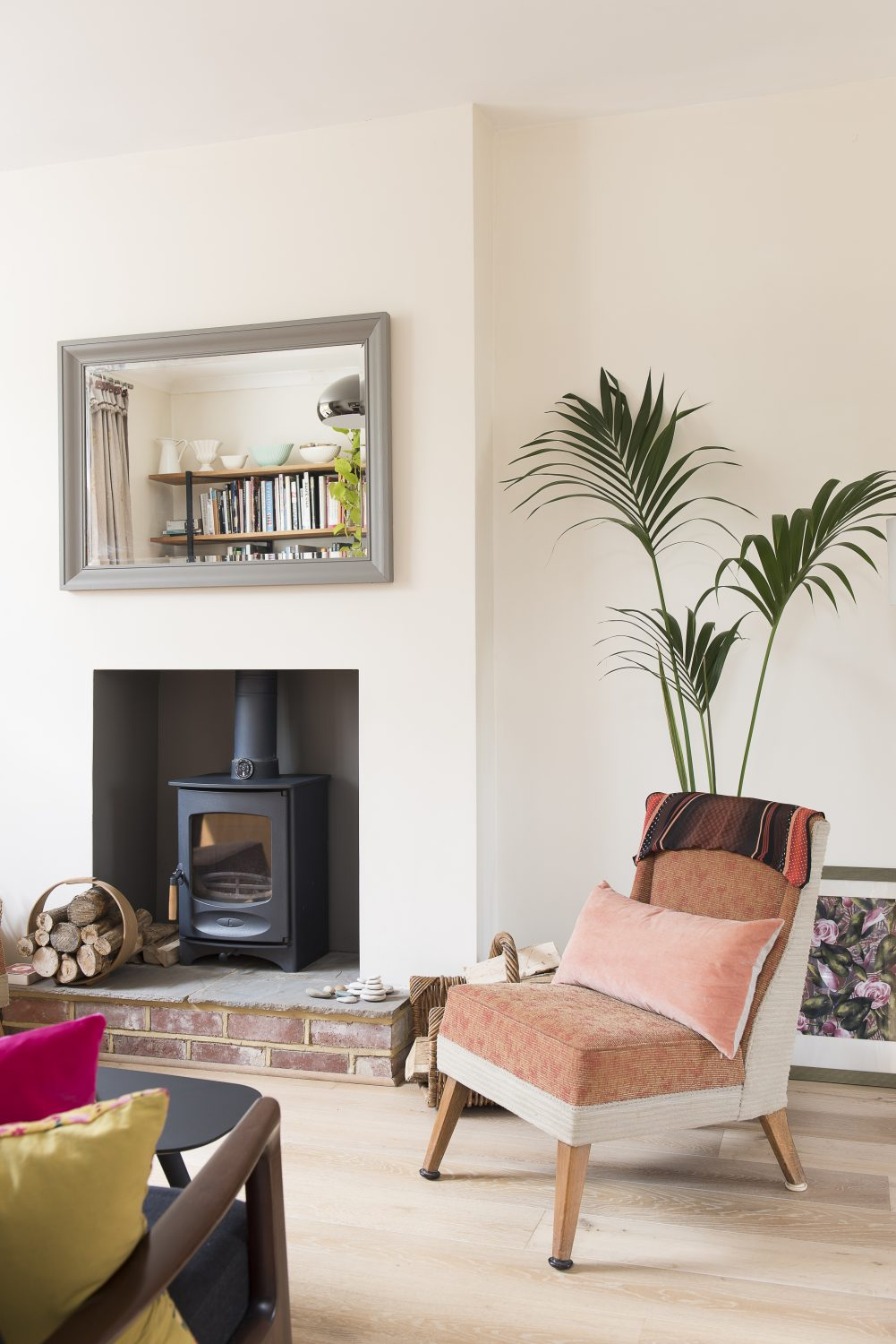 A woodburning stove keeps the sitting room cosy.