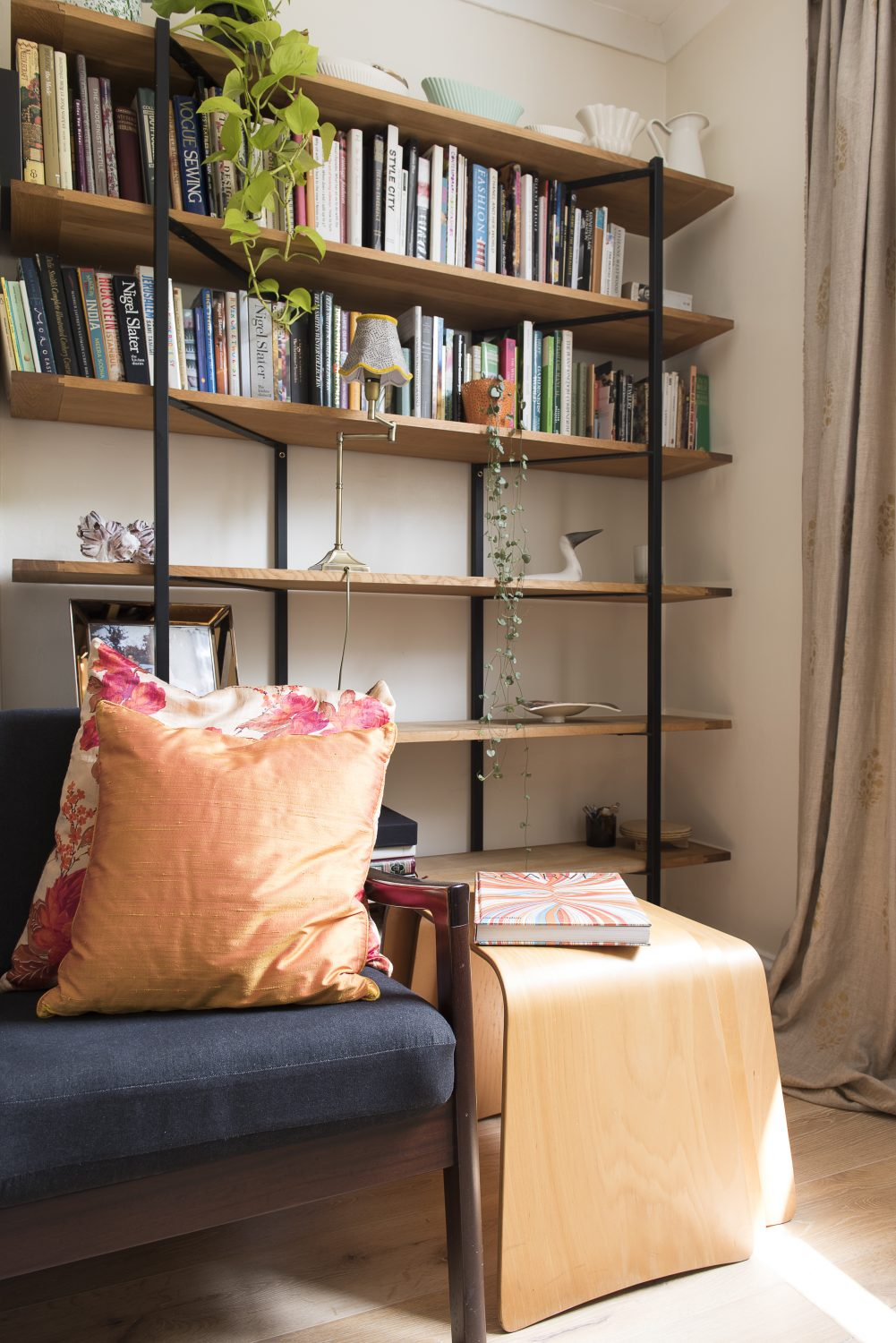 The living space had already been knocked through. The denim-covered sofa is by Danish designer Peter Jeppesen and the coffee table is from Heals. The shelving unit, left, is vintage Habitat