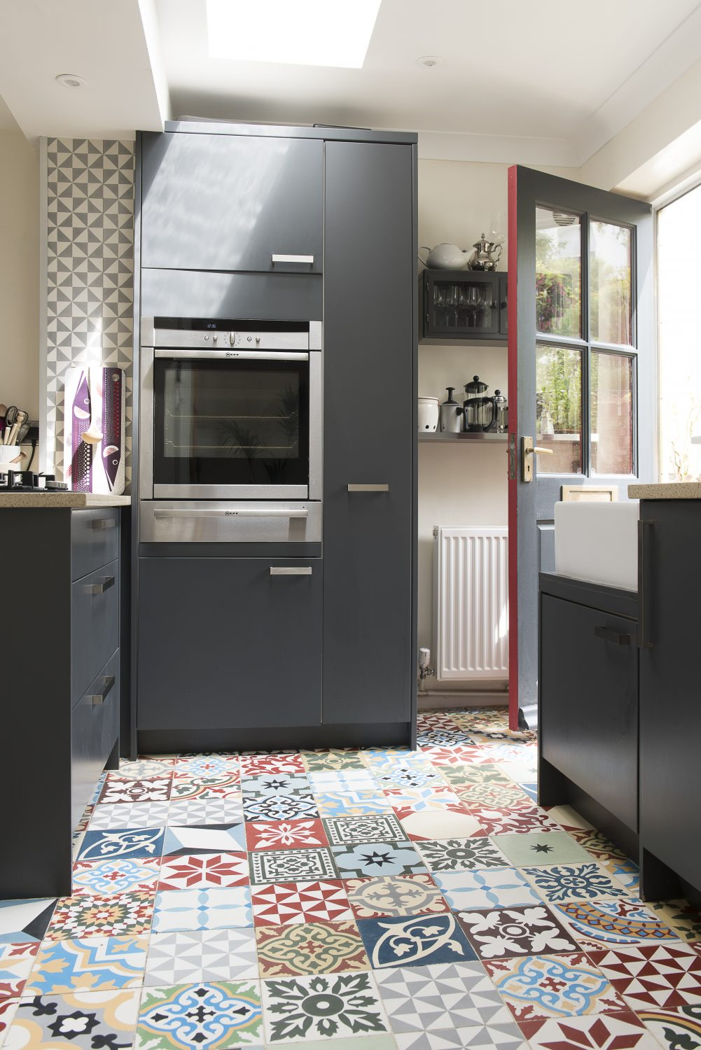The front door opens into the kitchen. The units are from Jewsons and the encaustic tiles are from Encaustic Tiles Ltd