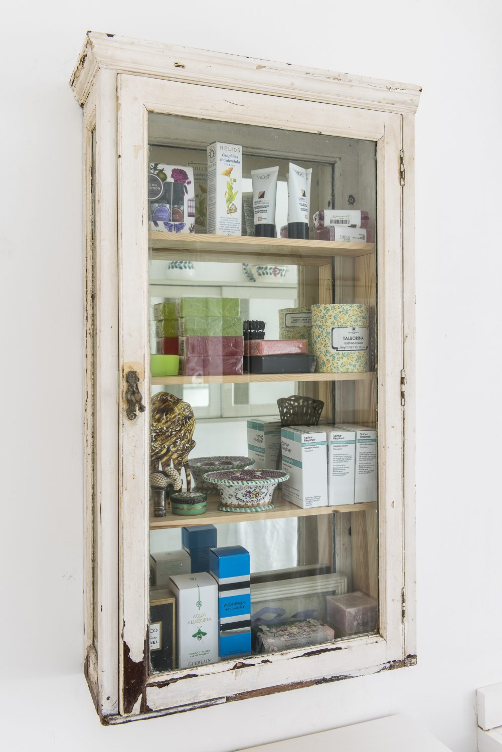 The vintage bathroom cabinet was given to Sasha by her brother, fashion illustrator and designer Gavin Waddell