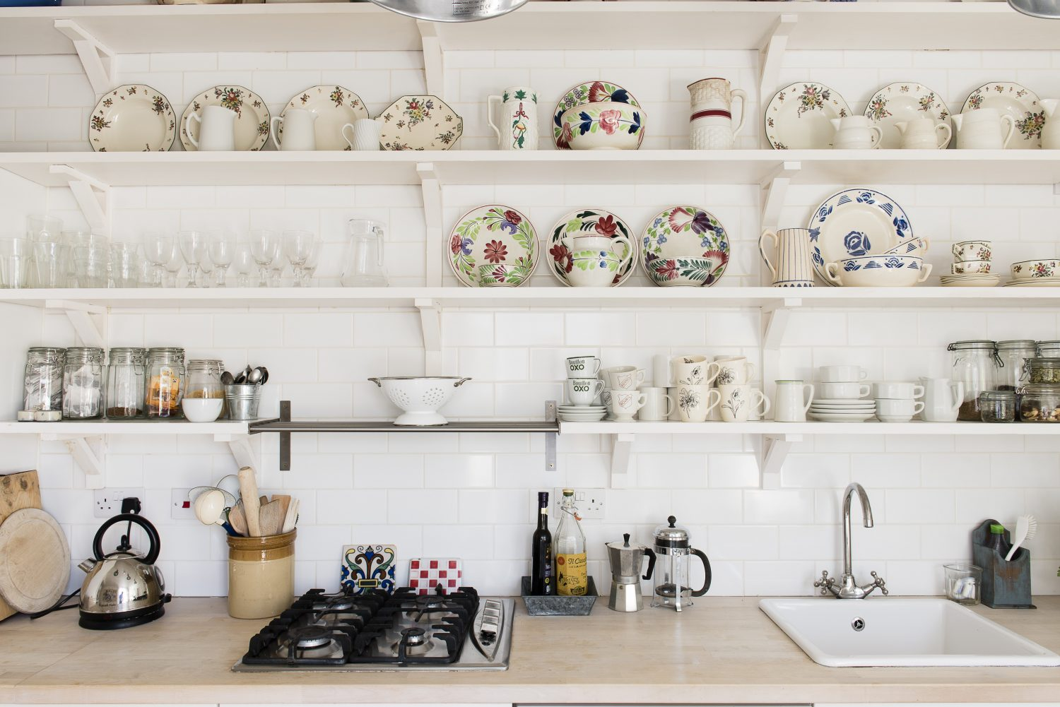 The kitchen shelves adorned with colourful kitchenware
