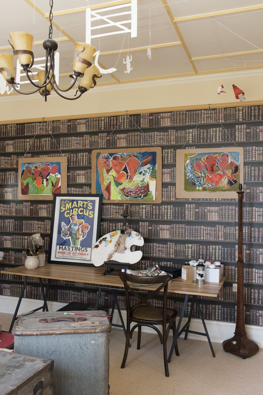 The upstairs room is known as the library because of the book wallpaper
