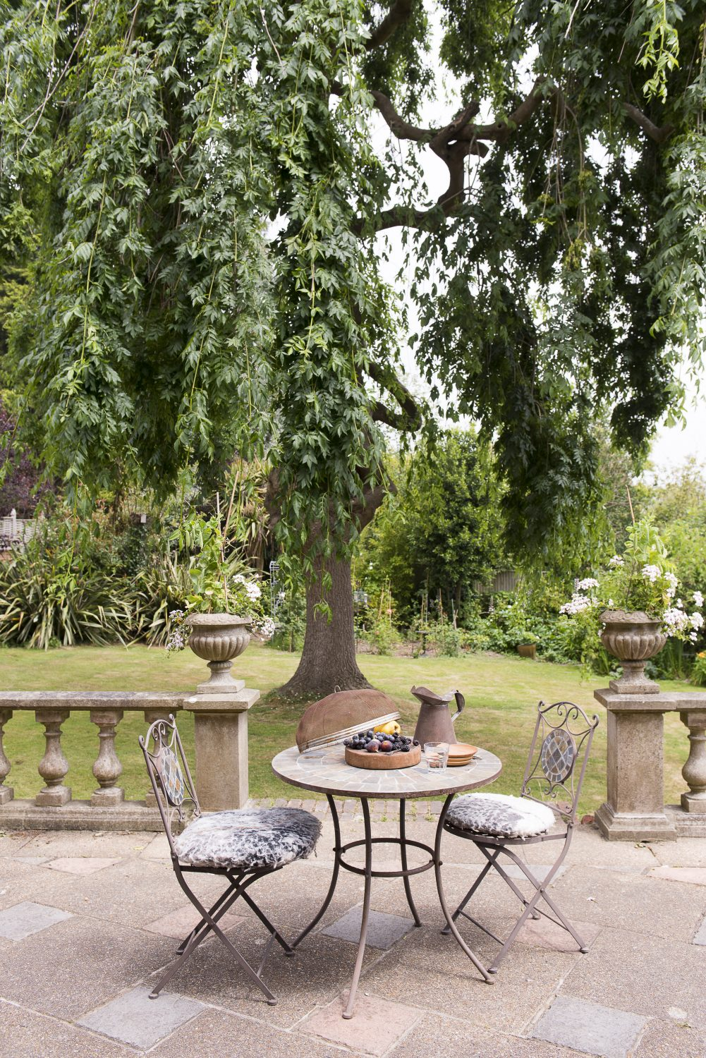 The terrace overlooks the garden in which the company have created a series of outdoor rooms used for rehearsals
