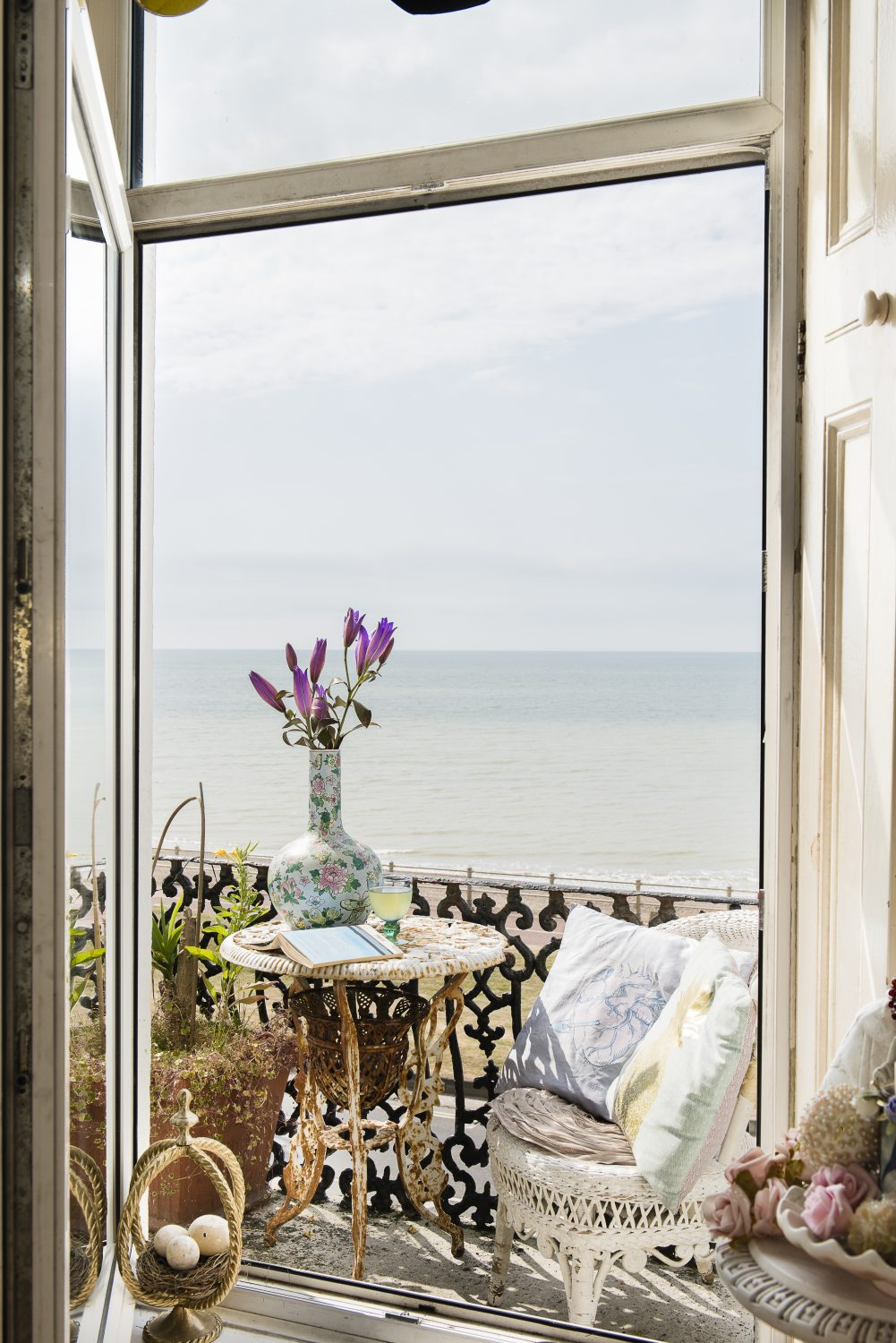 The stunning sea views from Sassy's wrought iron balcony are a constant source of inspiration and a contrast to her gloriously quirky style inside