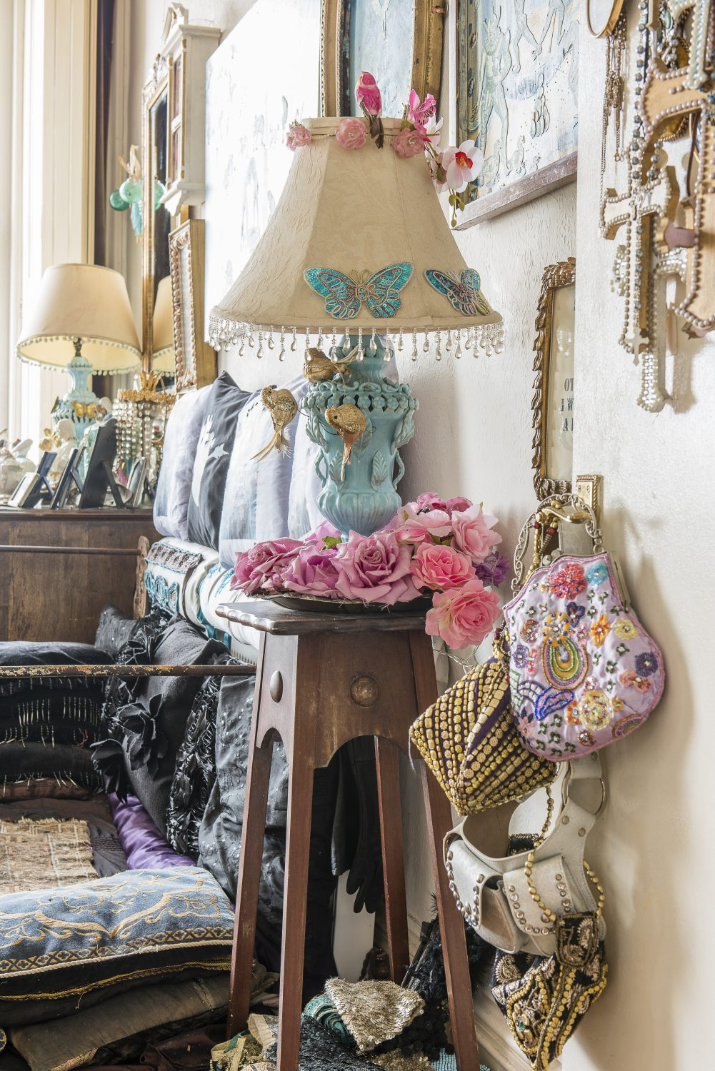 Sassy saves space by displaying beautiful items which are usually stowed away; bags are hung on door handles and jewellery is set out on a Georgian writing desk