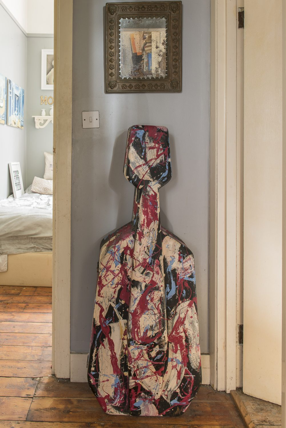 An abstract painted cello case by Jameson Keane