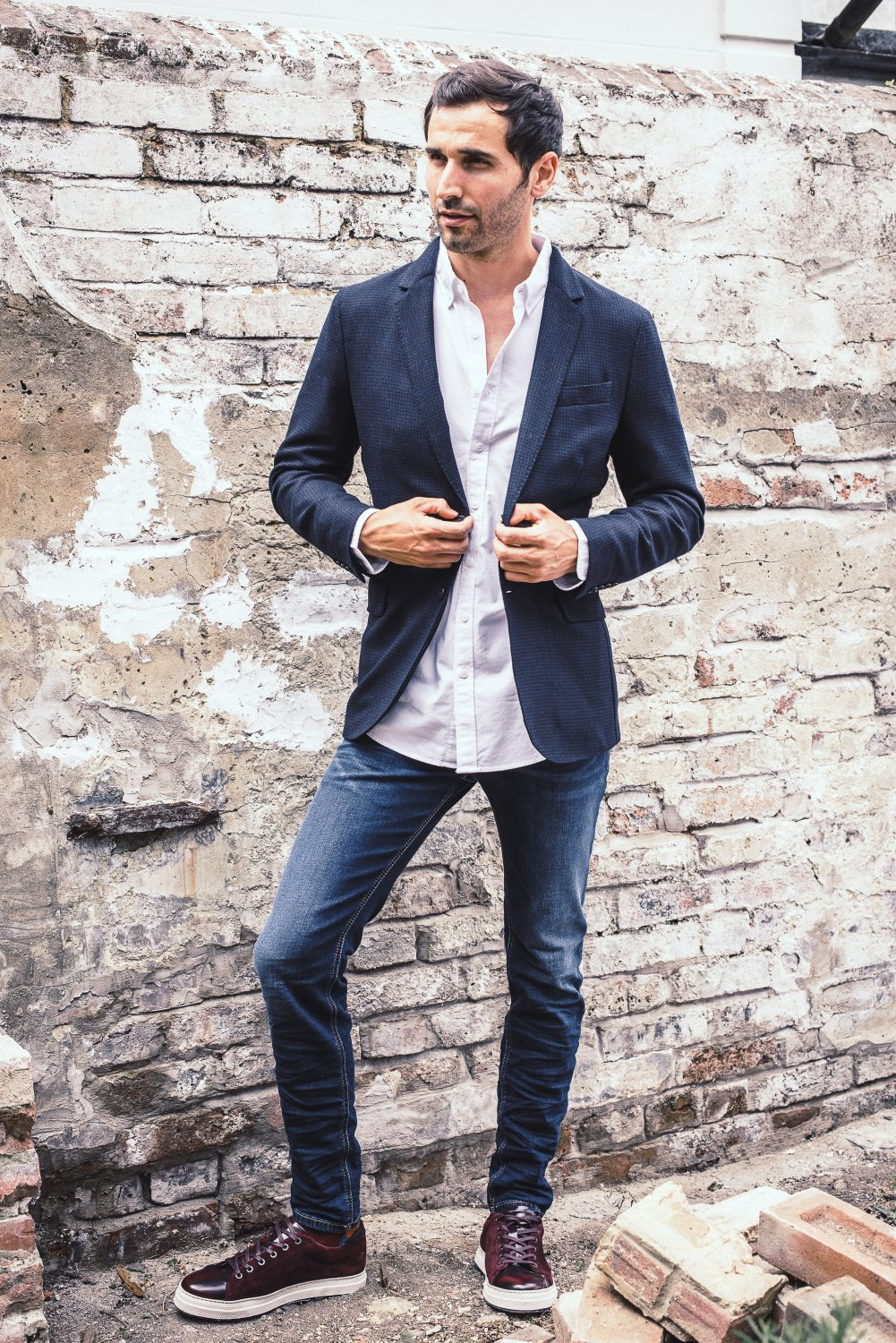 Slip a jacket over an untucked shirt for a relaxed look that isn't sloppy