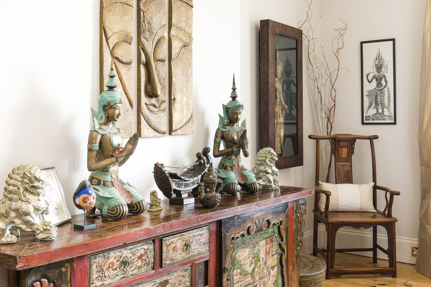 Chris and Lillie found the antique Mongolian cabinet at Yi Ju in Tunbridge Wells, along with the Chinese chair. The brass statues were found in Bangkok