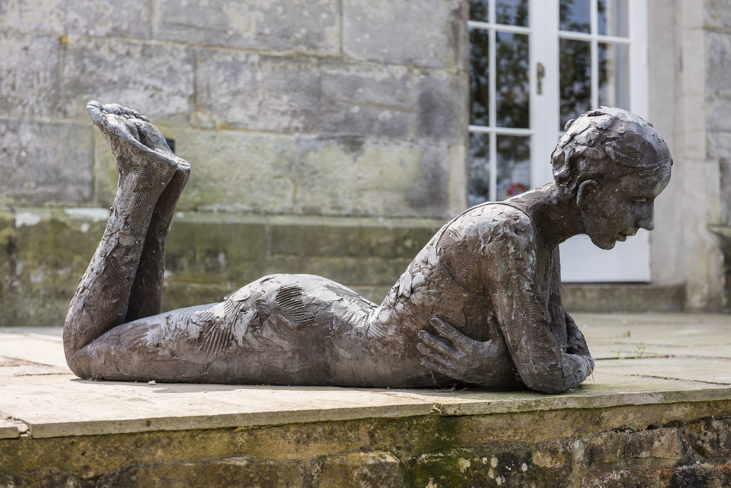 Sculptures by Carol Peace and Dawn Benson add interest on the terrace and among the borders