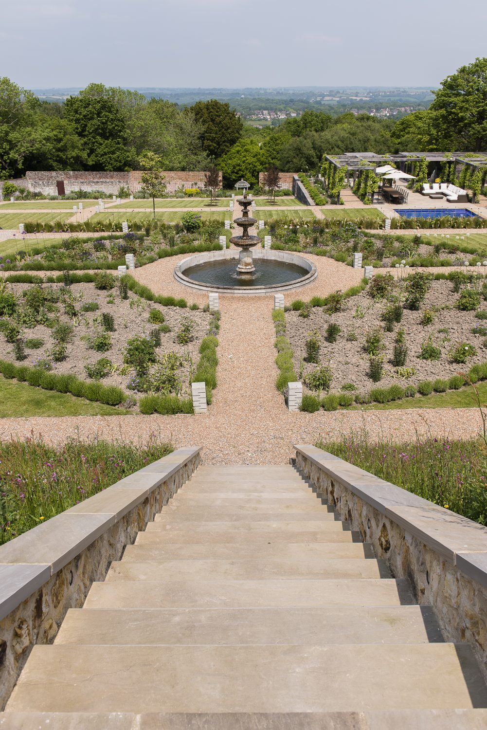 Chris designed the main part of the garden on a formal scheme, with gravel paths dividing the beds around the fountain