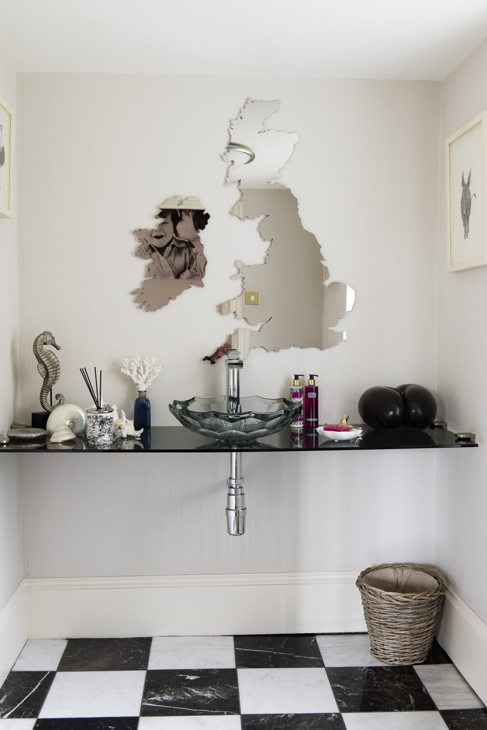 A bespoke laser-cut United Kingdom and Ireland mirror in the downstairs loo