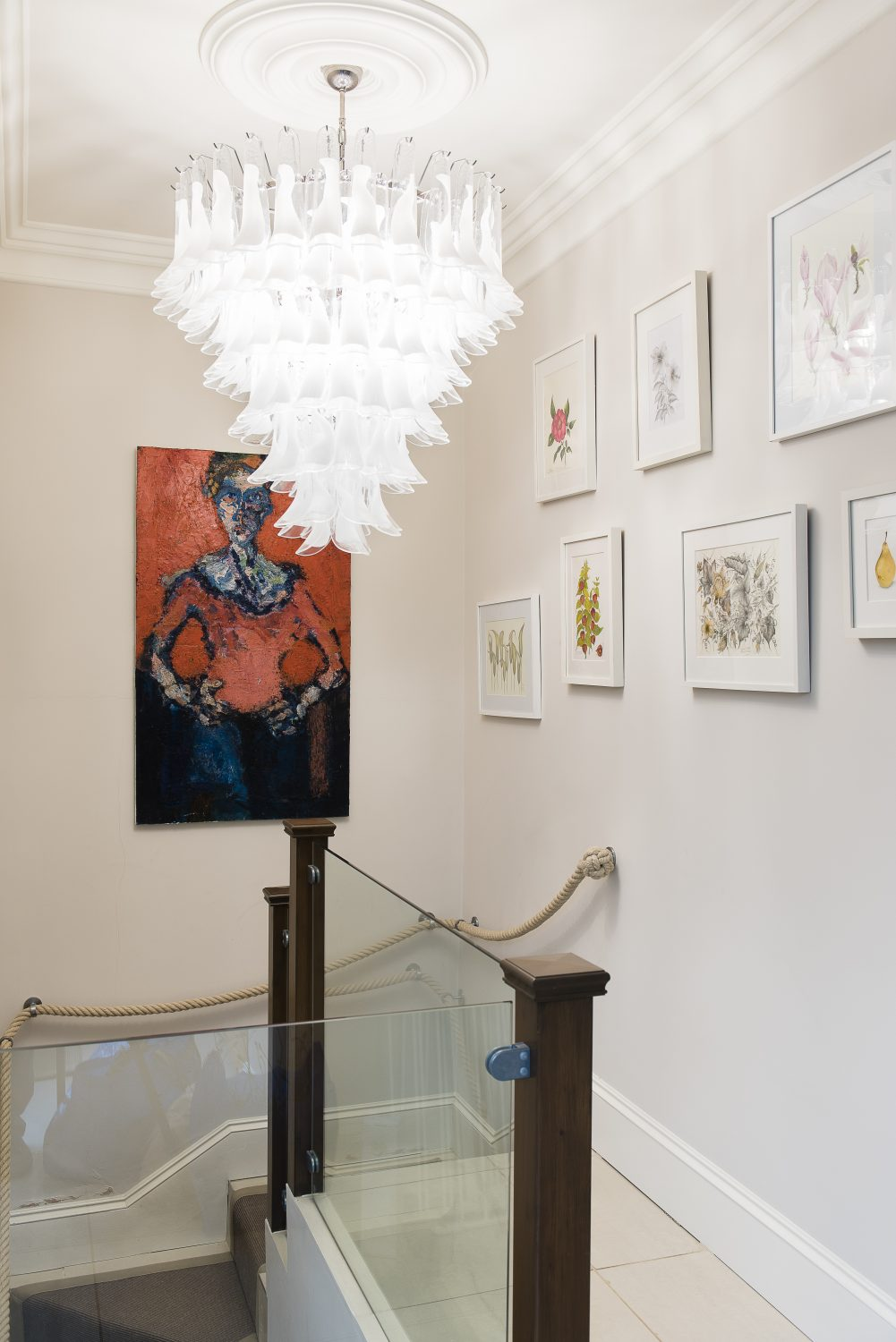 Original botanical paintings by Lillie's mother line the landing. The feature light is from Nuova Venier in Murano, Venice