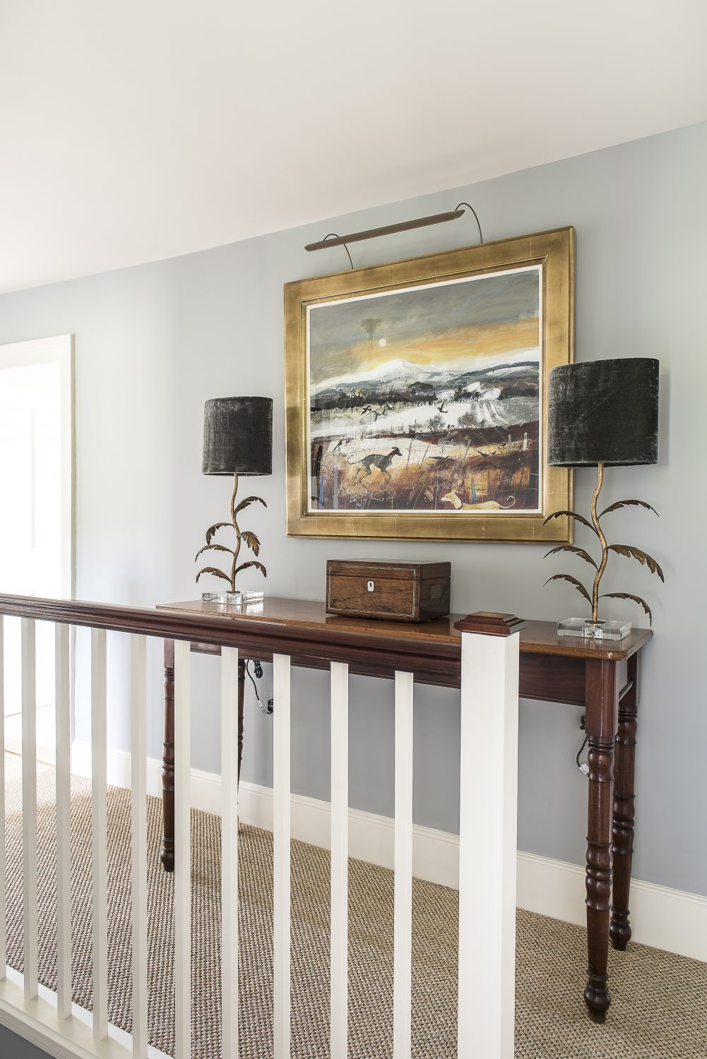 The lamps on the landing console table are from Porta Romana and the painting client's own