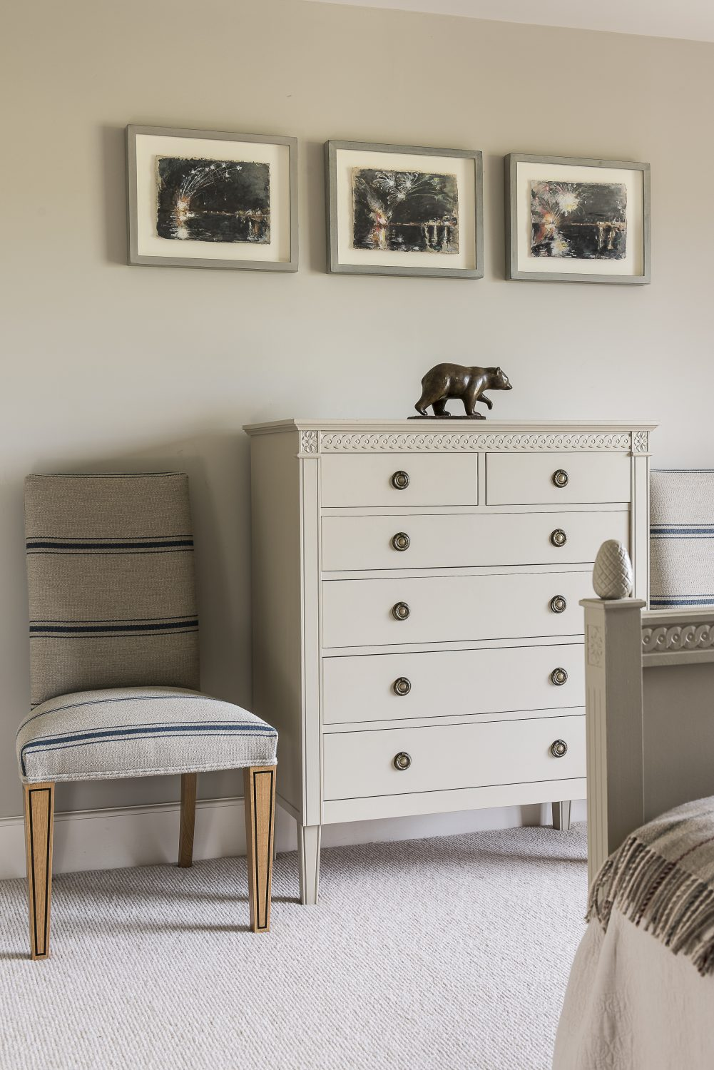The chest of drawers is client's own and the chairs are covered in William Yeoward stripe