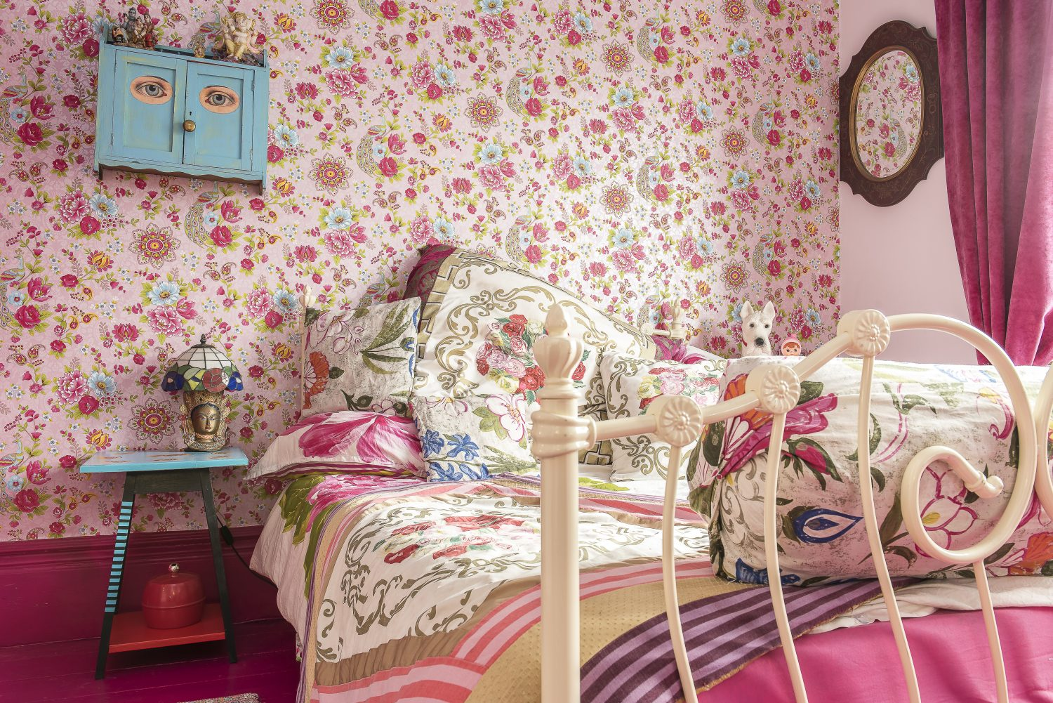 The wallpaper in the guest bedroom is by Pip Studio.