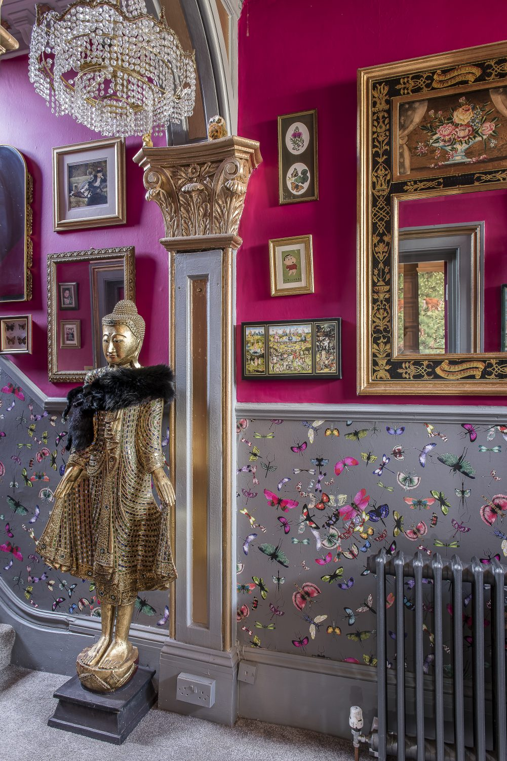 With its wall of mirrors, the hallway is Annemarie's 'homage to Versailles'. The butterfly wallpaper in the hall and up the stairs is by Christian Lacroix