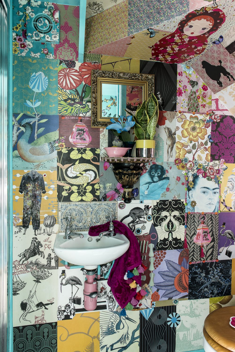 Annemarie decoupaged the walls of the downstairs shower room with wallpaper samples and magazine pages. It took three days